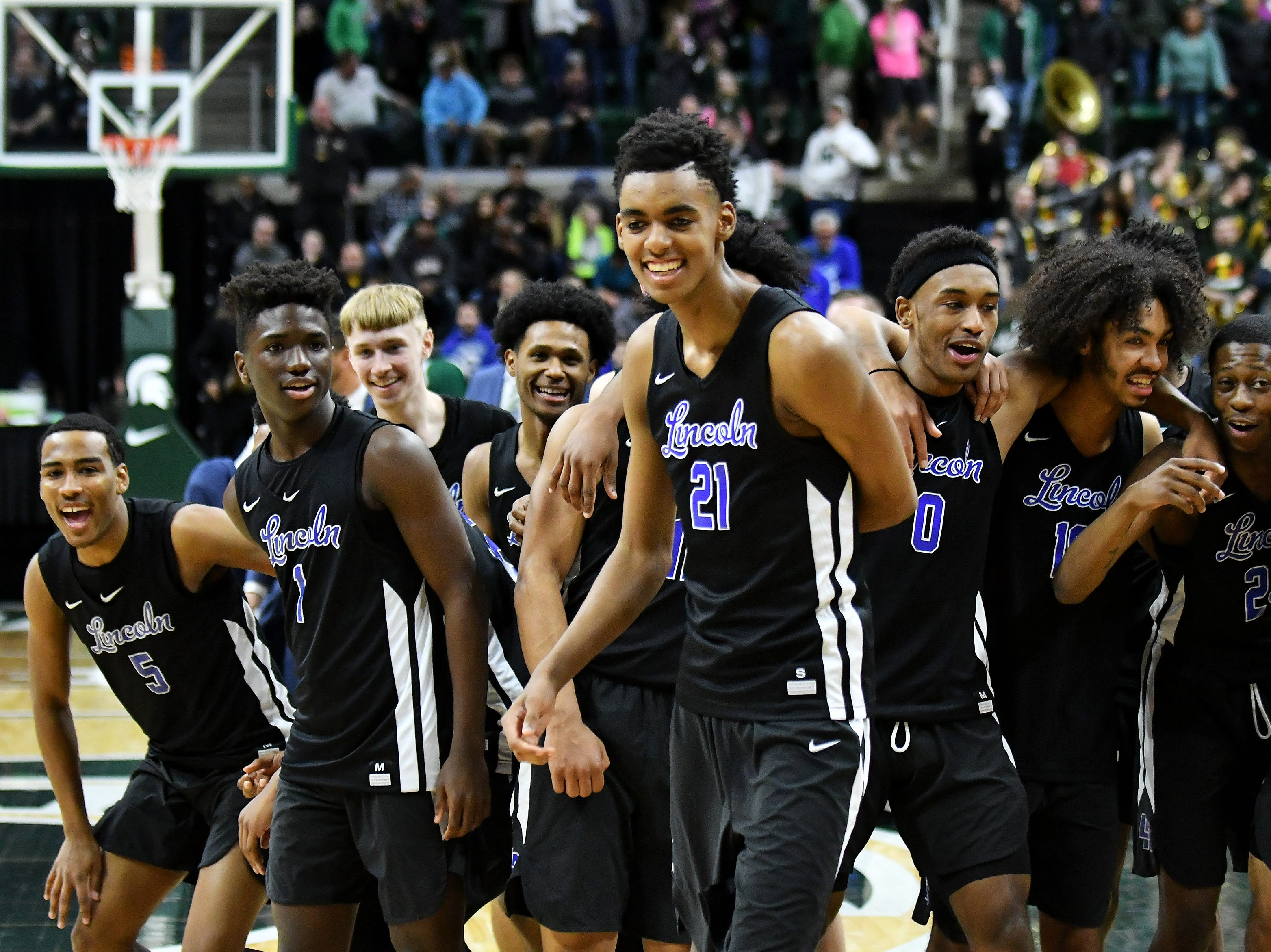 Lincoln's Emoni Bates (21) and his teammates react after defeating Howell 72-56 in the Division 1 semifinals at the Breslin Center in East Lansing, Mich. on March 15, 2019.