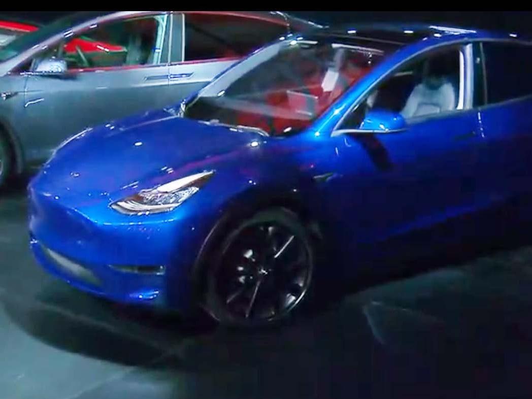 At alst. The Tesla Model Y SUV gets its debut at the EV brand's LA design studio just before midnight EST Thursday.