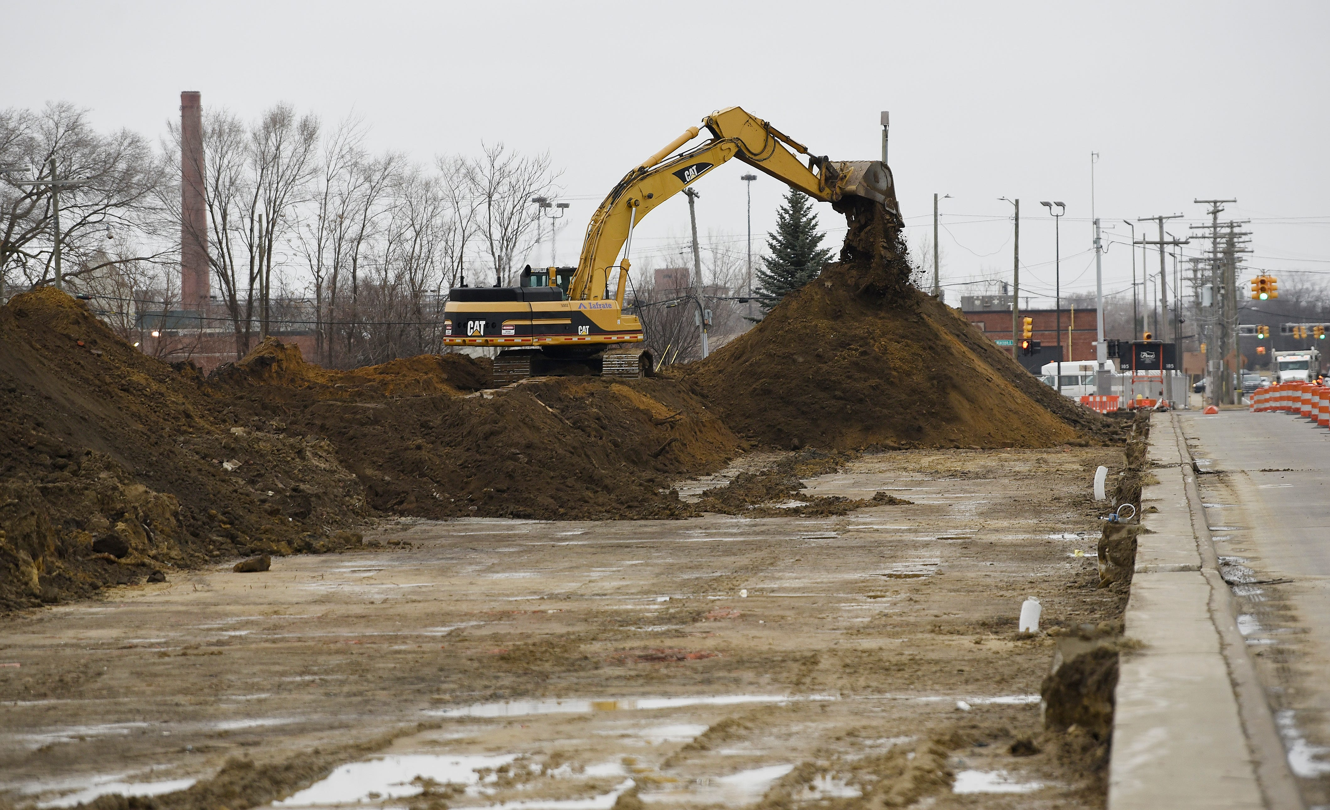 A operator from Iafrate Construction Co. uses a excavator to remove soil from land on St. Jean just south of East Warren in Detroit, Friday, March 15. The land is part of the 200 acres that the city needs to acquire for the proposed Fiat Chrysler Mack Avenue Assembly complex.