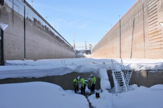 Chris Albraugh, left, Steve Robbins  and Josh Schwab work on a steam line in the Poe Lock, March 12, 2019. Steam will melt all ice and water in the lock and be drained prior to re-watering the lock on March 18.