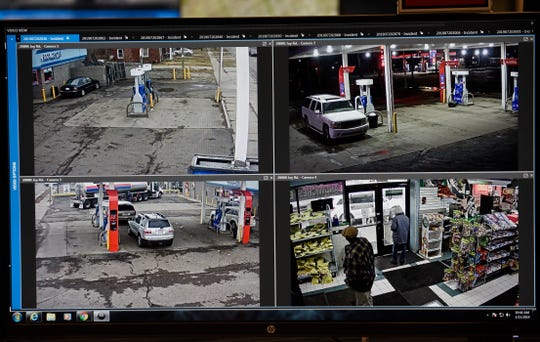 This photo shows four different live camera feeds from the same business, a west-side Detroit gas station. The real-time video is monitored by members of the Project Green Light program.
