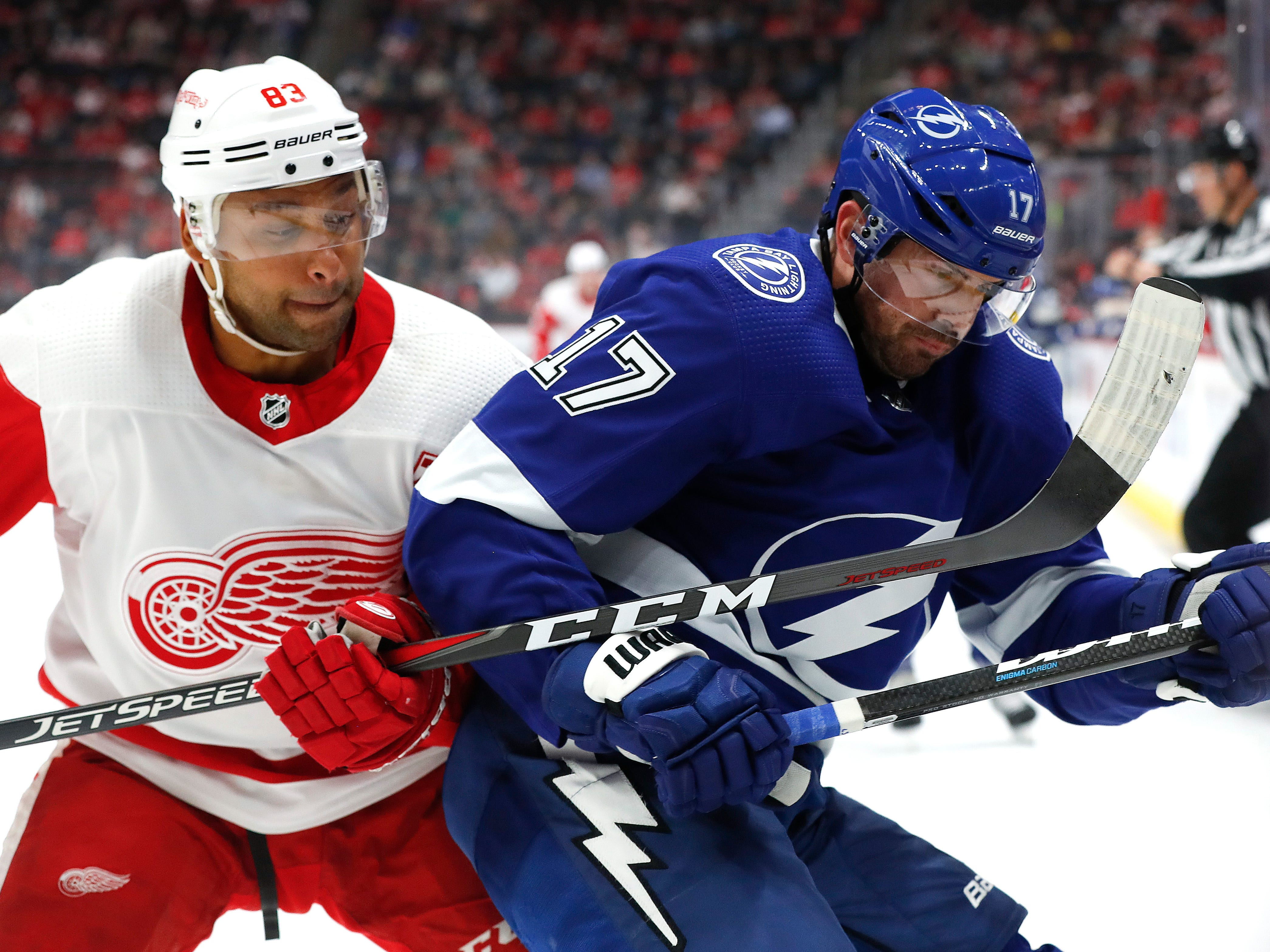 Detroit Red Wings defenseman Trevor Daley (83) and Tampa Bay Lightning left wing Alex Killorn (17) battle for the puck in the first period.