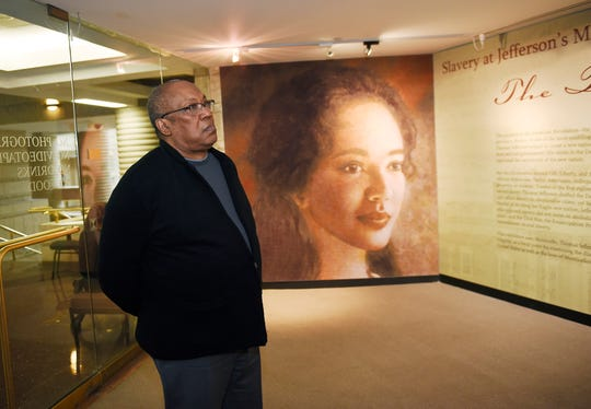 Neil A. Barclay, CEO and President of the Charles H. Wright Museum, observes one of the exhibits.