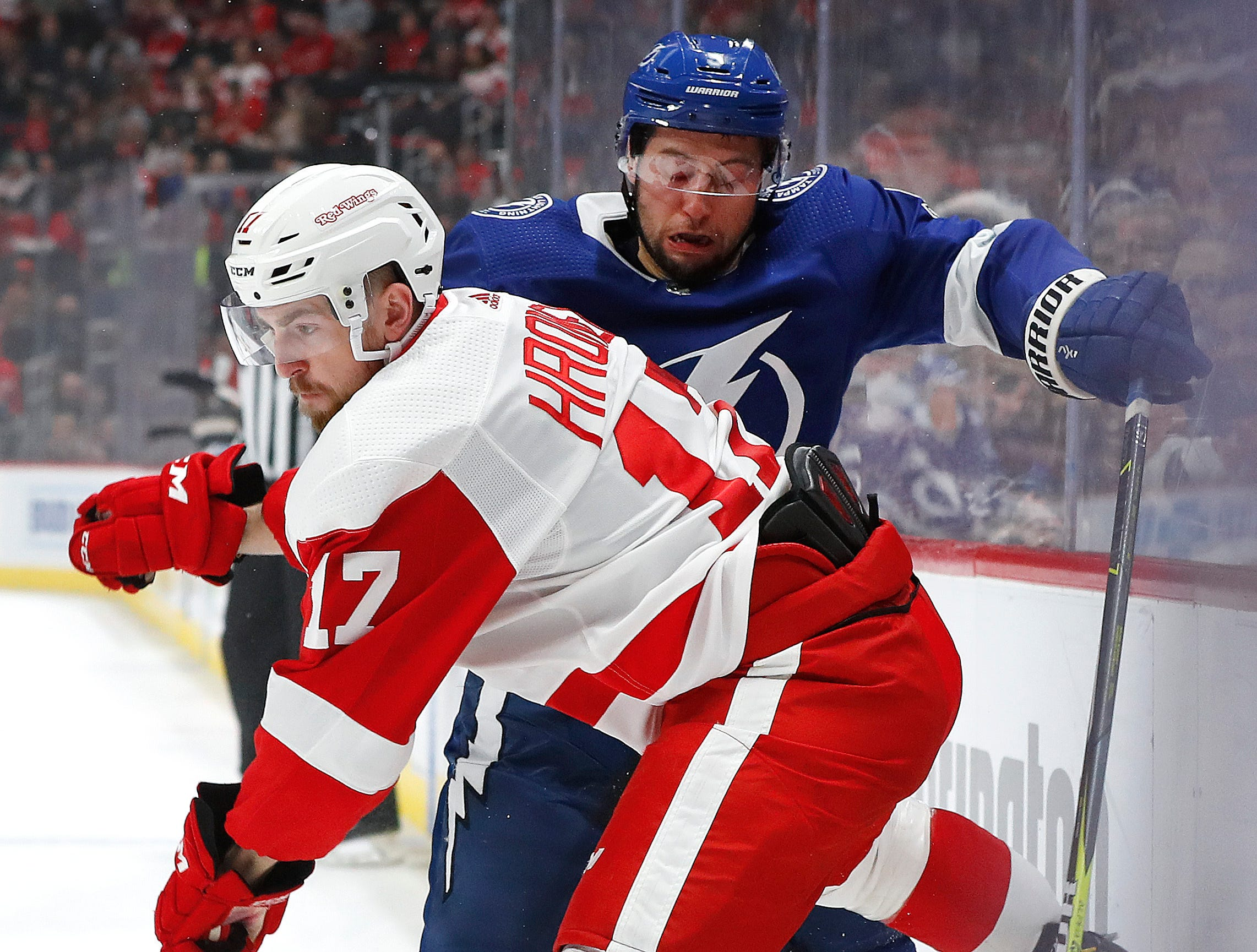 Detroit Red Wings defenseman Filip Hronek (17) checks Tampa Bay Lightning center Tyler Johnson (9) in the first period.