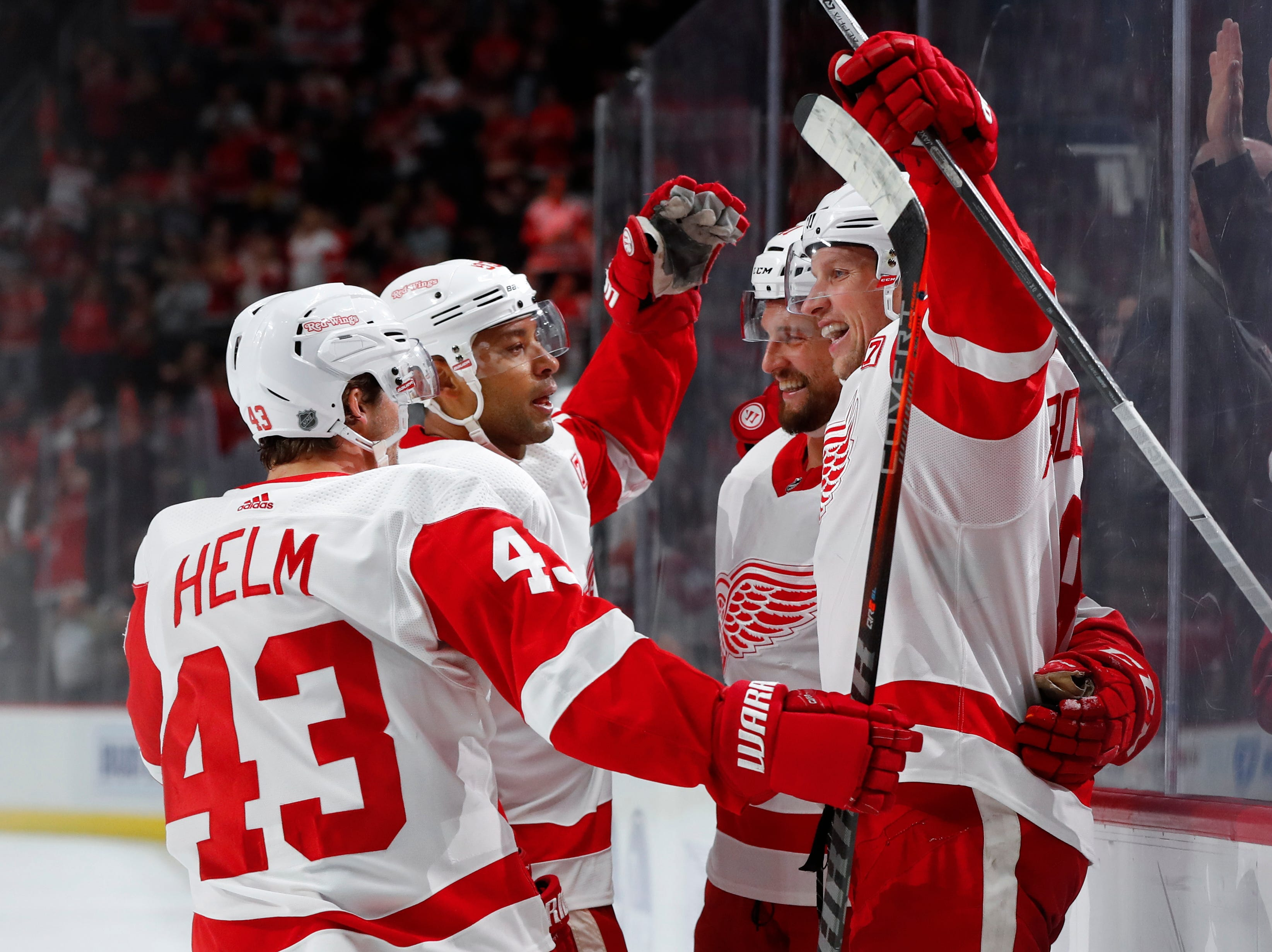 Detroit Red Wings left wing Justin Abdelkader, from right, celebrates his goal with Luke Glendening, Trevor Daley and Darren Helm (43) in the second period.