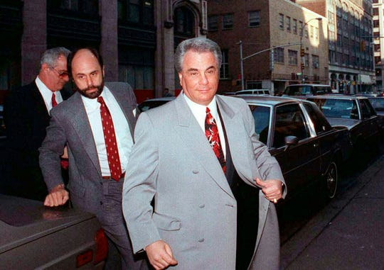 In this Feb. 9, 1990 file photo, John Gotti, right, arrives at court in New York. The Gambino family was once among the most powerful criminal organizations in the U.S., but federal prosecutions in the 1980s and 1990s sent Gotti and other top leaders to prison, diminishing its reach.
