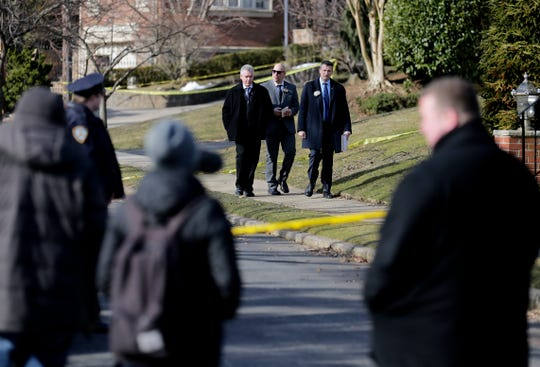 Police work near the scene where an alleged leader of the Gambino crime family was shot and killed in the Staten Island borough of New York, Thursday, March 14, 2019.