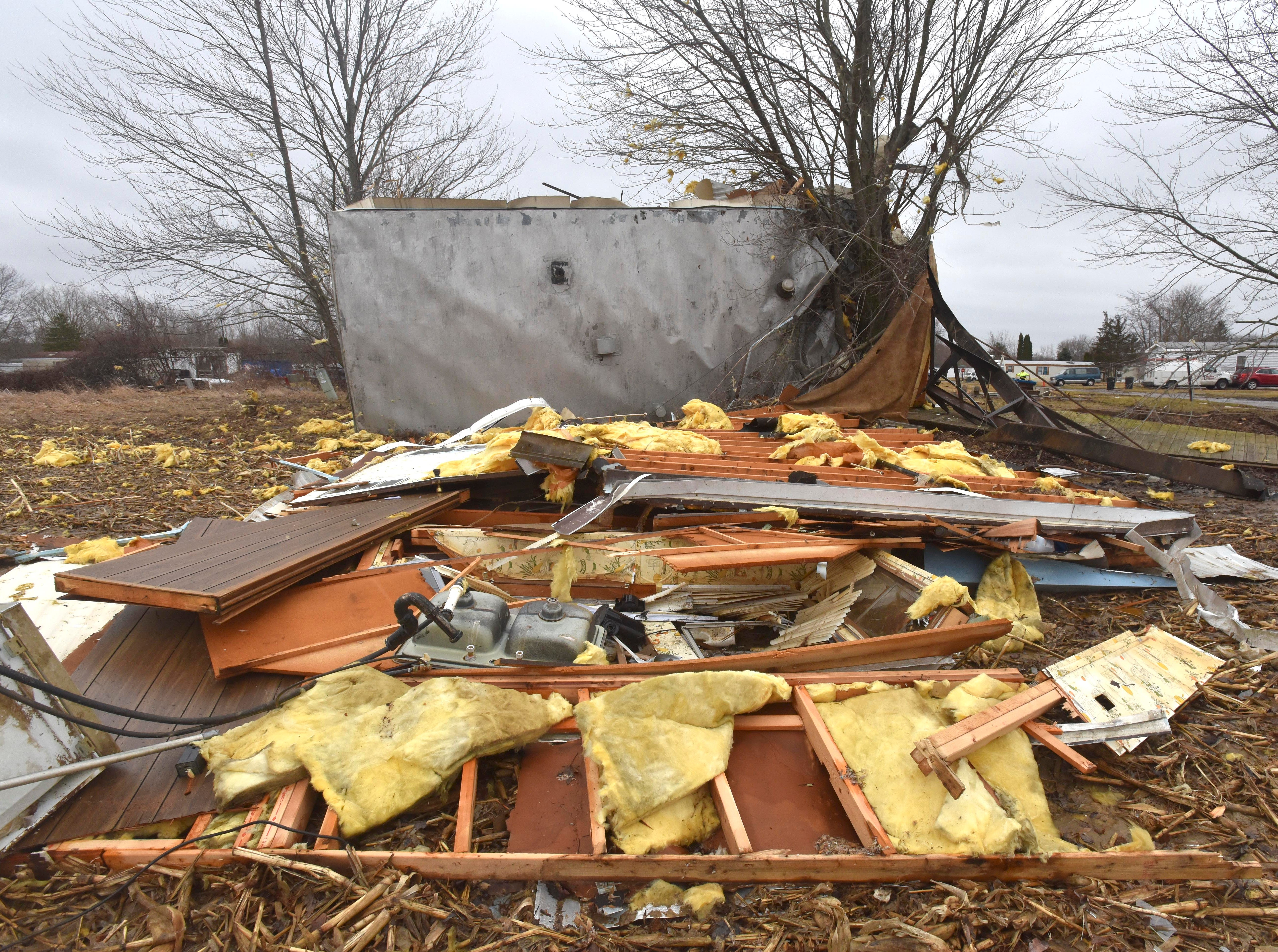 The wreckage of a mobile home in Mount Morris in Genesee County is seen Friday, after a tornado Thursday night lifted it off its foundation. Authorities say two tornadoes swept through mid-Michigan, damaging more than 60 homes and knocking out power to thousands.