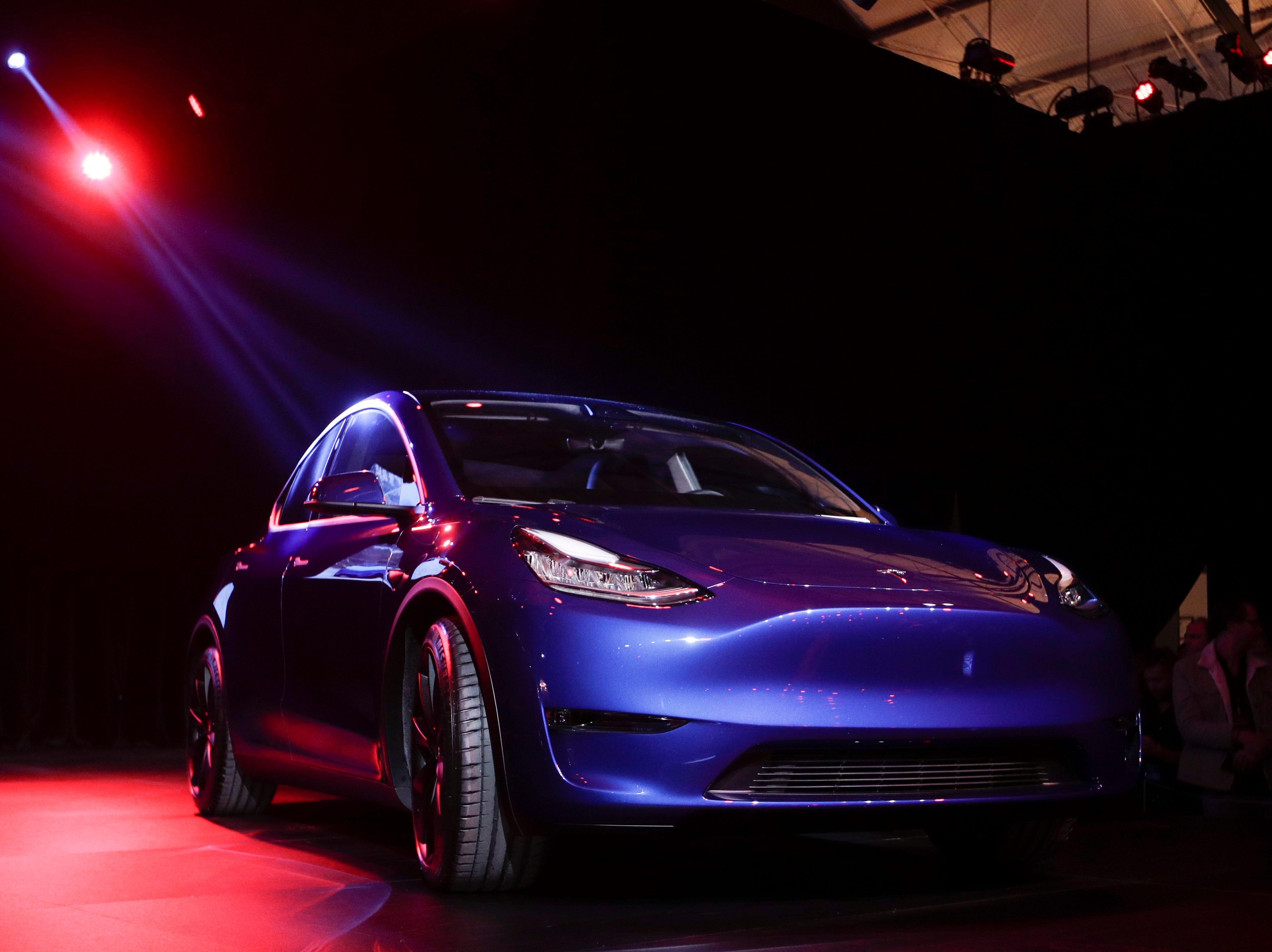 The Tesla Model Y is unveiled at Tesla's design studio in Hawthorne, Calif. Thursday, March 14, 2019.