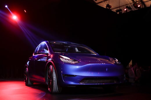 The Tesla Model Y is unveiled at Tesla's design studio in Hawthorne, Calif. Thursday, March 14, 2019.