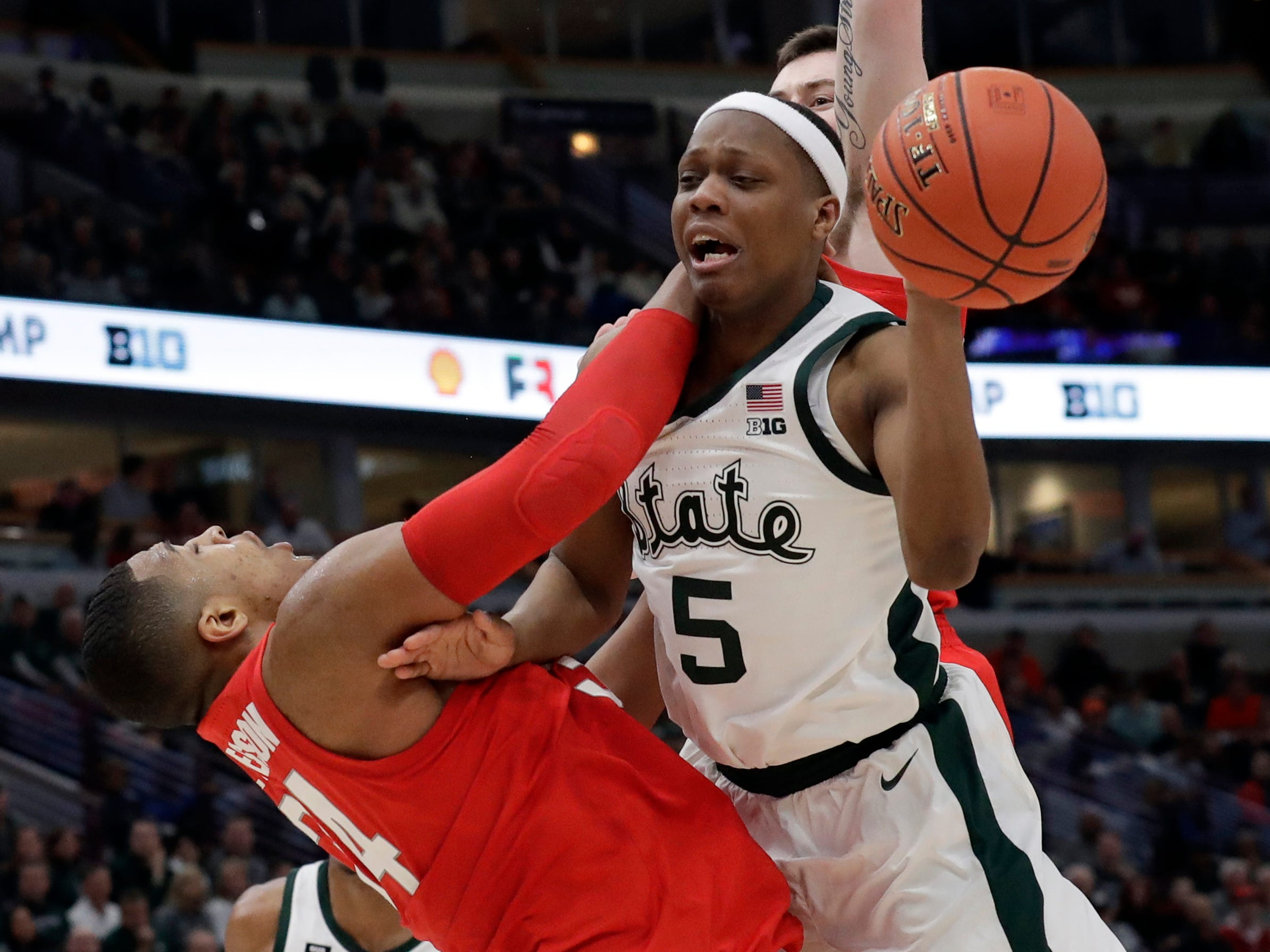 Michigan State's Cassius Winston (5) is drives against Ohio State's Andre Wesson (24) during the second half.