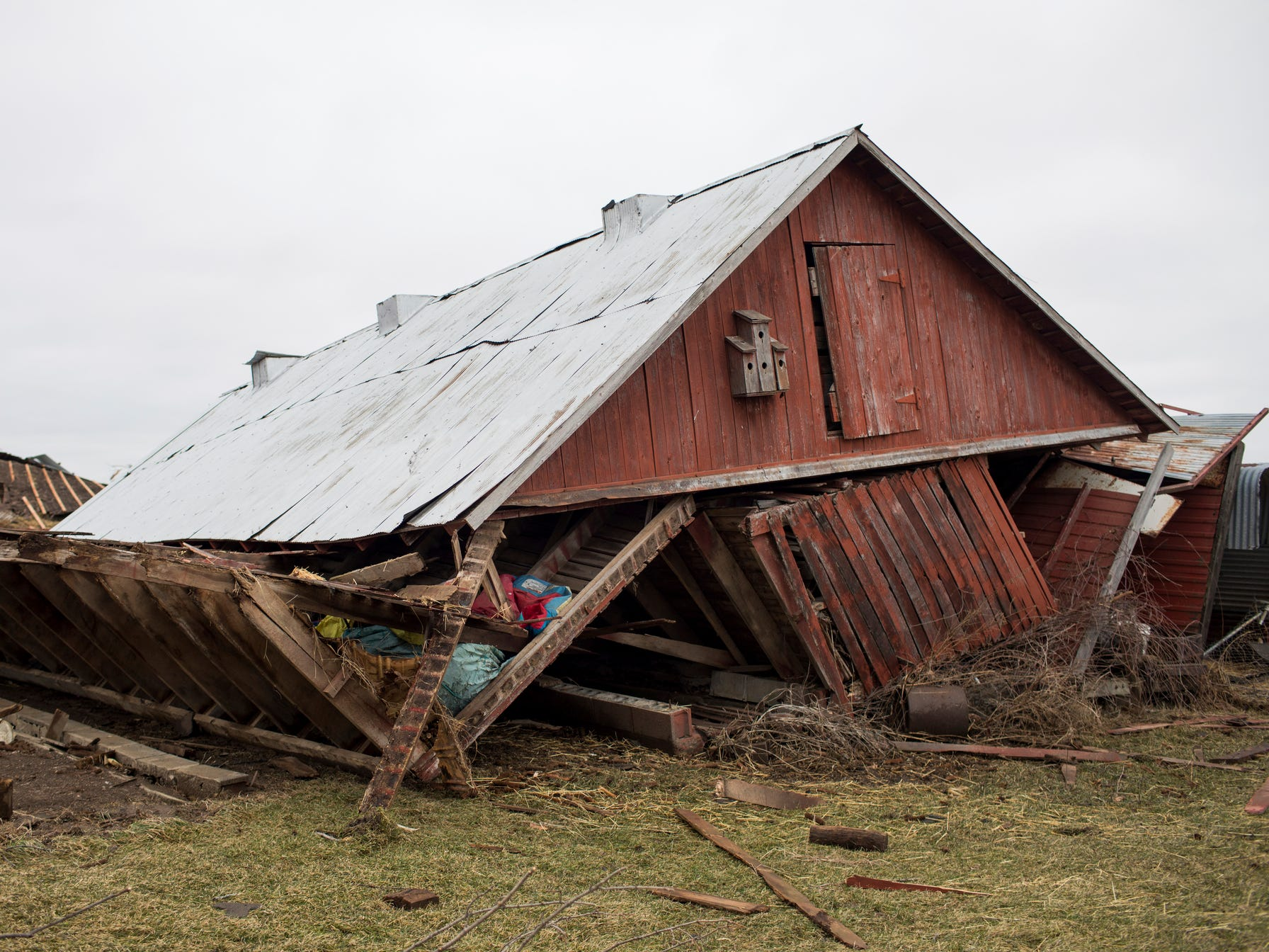 Debris lies on the ground near a barn after a tornado Friday in Vernon, Michigan. Authorities say a tornado swept through mid-Michigan, damaging homes and knocking out power to thousands.