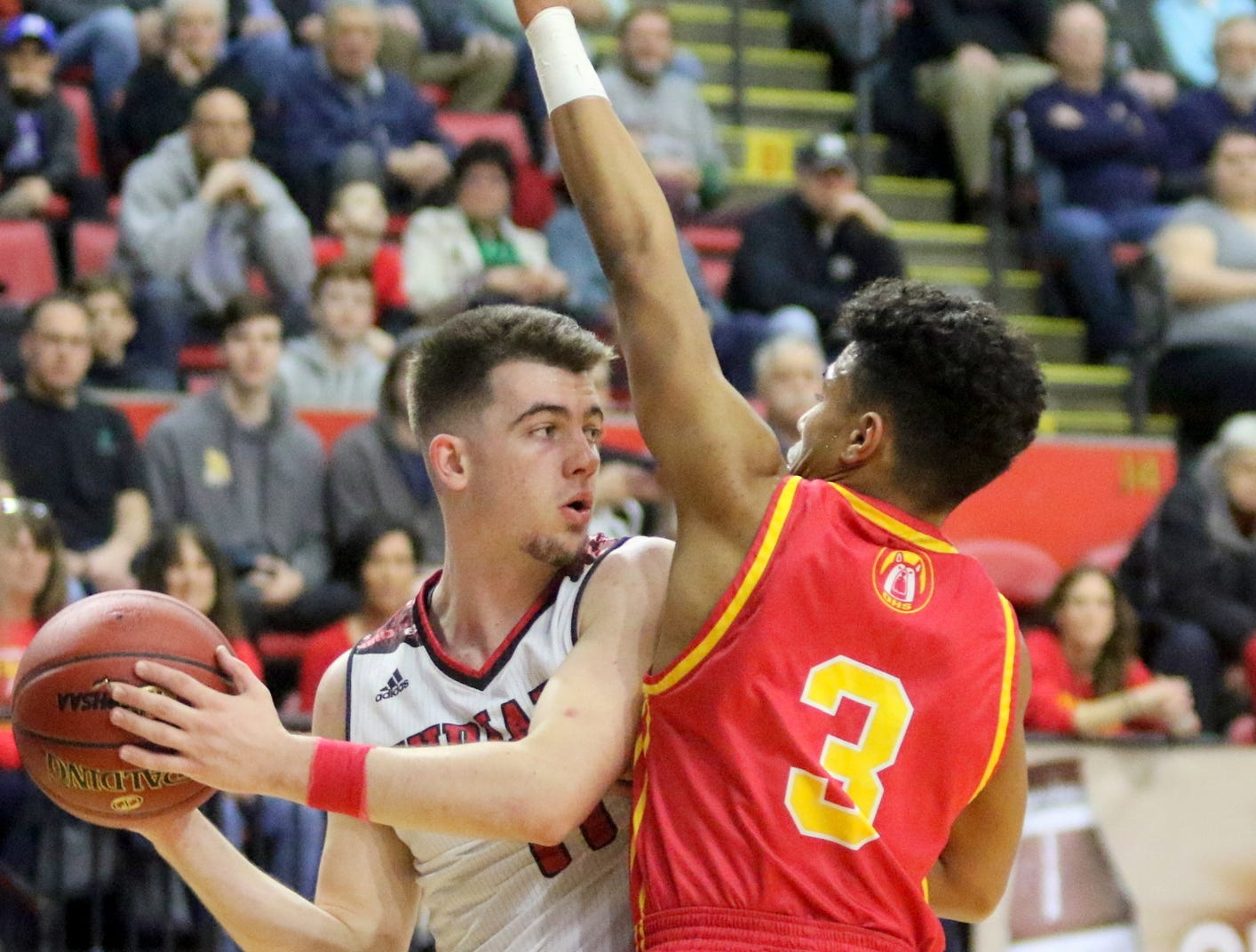 Joseph Girard III of Glens Falls is defended by Olean's Alex Weakfall during an 83-63 win in a Class B boys basketball state semifinal March 15, 2019 at Floyd L. Maines Veterans Memorial Arena in Binghamton.