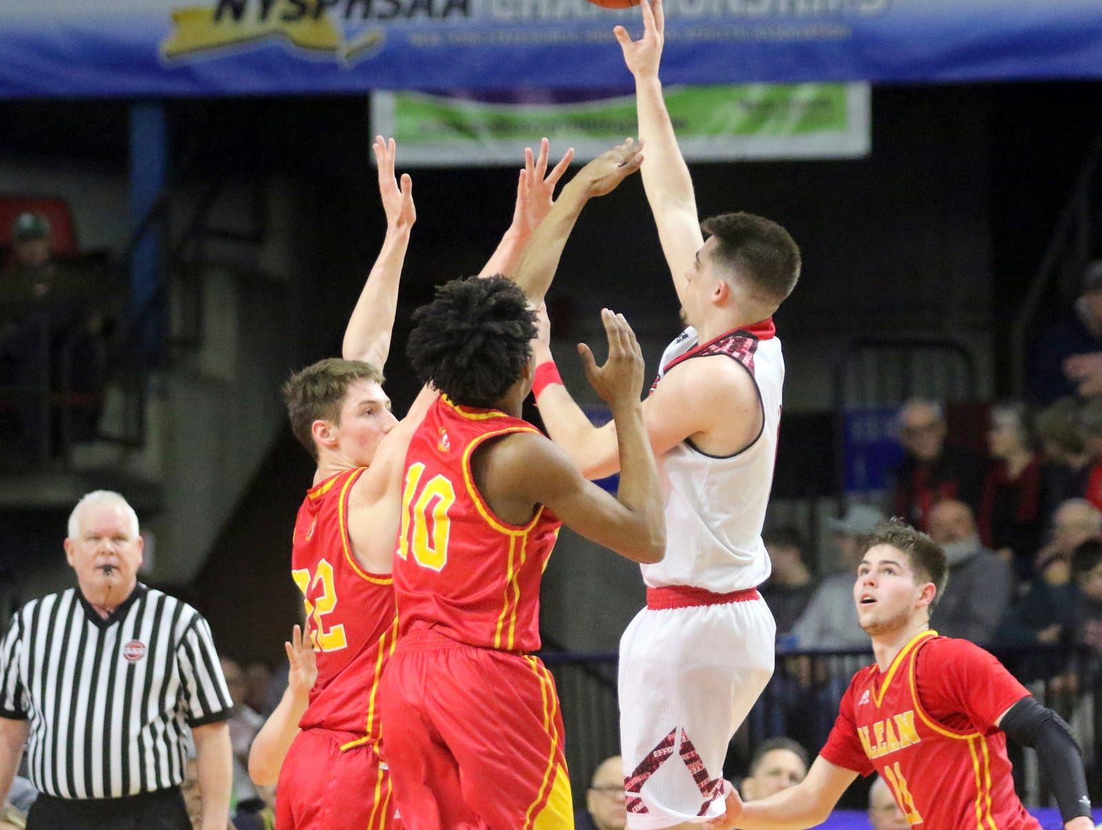 Joseph Girard III of Glens Falls puts up a shot during an 83-63 win over Olean in a Class B boys basketball state semifinal March 15, 2019 at Floyd L. Maines Veterans Memorial Arena in Binghamton.