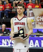 Joseph Girard III of Glens Falls receives his New York Mr. Basketball Award after an 83-63 win over Olean in a Class B boys basketball state semifinal March 15, 2019 at Floyd L. Maines Veterans Memorial Arena in Binghamton.