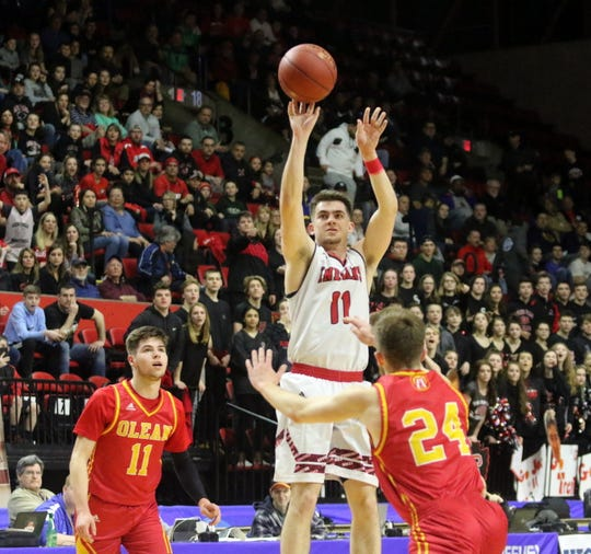 Joseph Girard III of Glens Falls takes a 3-pointer during an 83-63 win over Olean in a Class B boys basketball state semifinal March 15, 2019 at Floyd L. Maines Veterans Memorial Arena in Binghamton.