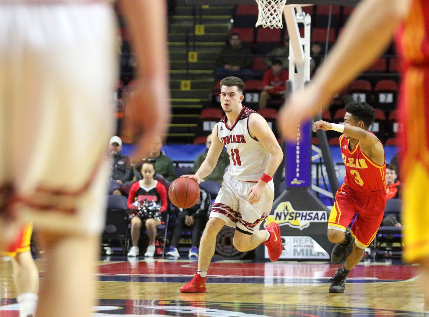 Joseph Girard III of Glens Falls dribbles up the court during an 83-63 win over Olean in a Class B boys basketball state semifinal March 15, 2019 at Floyd L. Maines Veterans Memorial Arena in Binghamton.