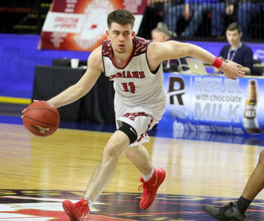 Joseph Girard III of Glens Falls drives to the basket during an 83-63 win over Olean in a Class B boys basketball state semifinal March 15, 2019 at Floyd L. Maines Veterans Memorial Arena in Binghamton.
