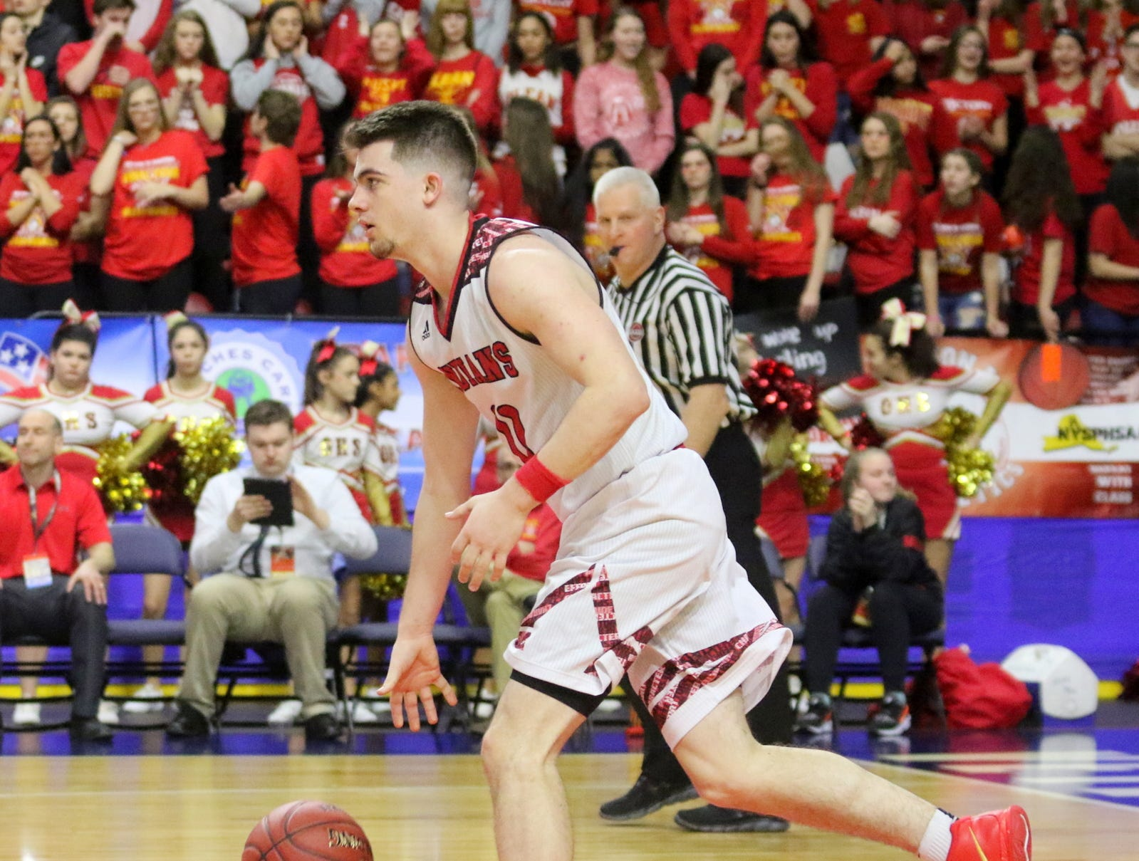 Joseph Girard III of Glens Falls takes the ball up the floor during an 83-63 win over Olean in a Class B boys basketball state semifinal March 15, 2019 at Floyd L. Maines Veterans Memorial Arena in Binghamton.