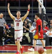 Joseph Girard III of Glens Falls exhorts the Glens Falls fans late in an 83-63 win over Olean in a Class B boys basketball state semifinal March 15, 2019 at Floyd L. Maines Veterans Memorial Arena in Binghamton.