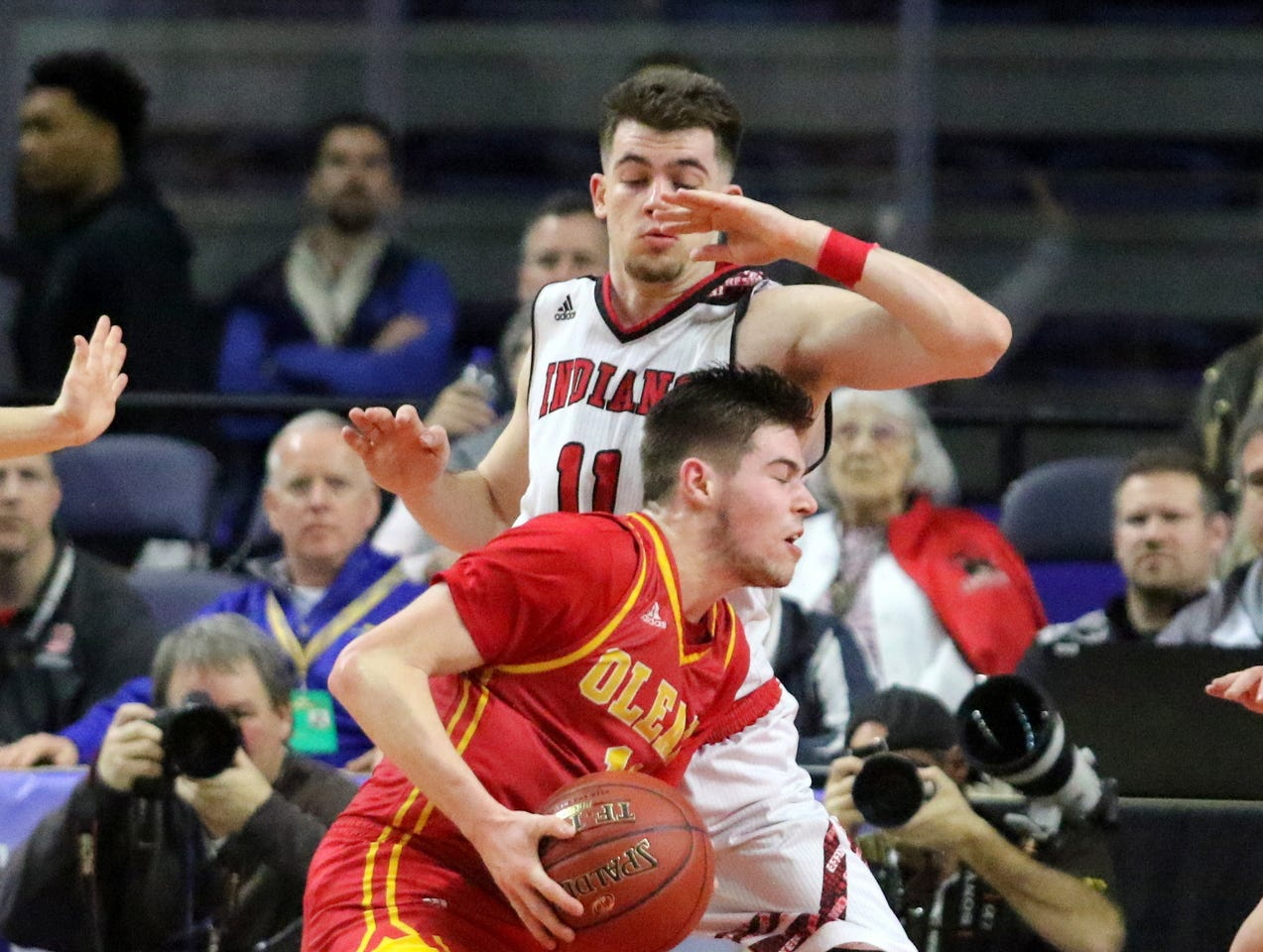 Joseph Girard III of Glens Falls defends Mike Schidt during an 83-63 win over Olean in a Class B boys basketball state semifinal March 15, 2019 at Floyd L. Maines Veterans Memorial Arena in Binghamton.