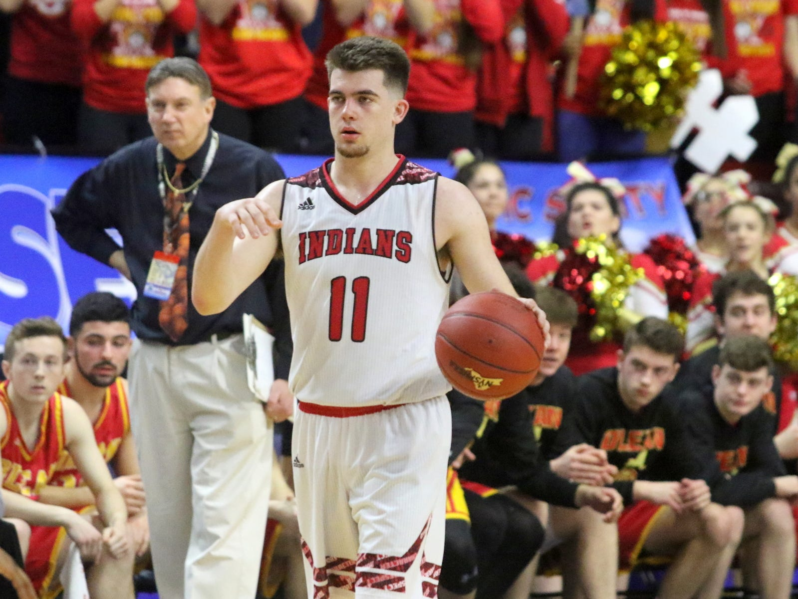 Joseph Girard III of Glens Falls takes a shot during an 83-63 win over Olean in a Class B boys basketball state semifinal March 15, 2019 at Floyd L. Maines Veterans Memorial Arena in Binghamton.
