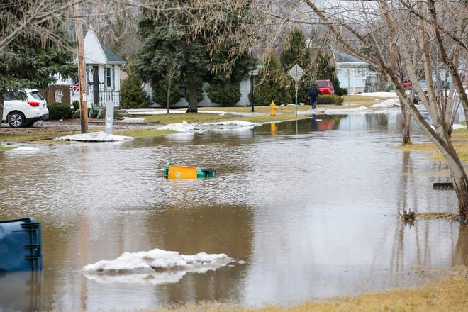 Flood waters remain Friday, March 15, 2019 on north Bell Street south of Johnson Street in Fond du Lac, Wis. Ice jams on the east branch of the Fond du Lac River and heavy rain caused widespread flooding problems in the city on Thursday the 14th. Doug Raflik/USA TODAY NETWORK-Wisconsin