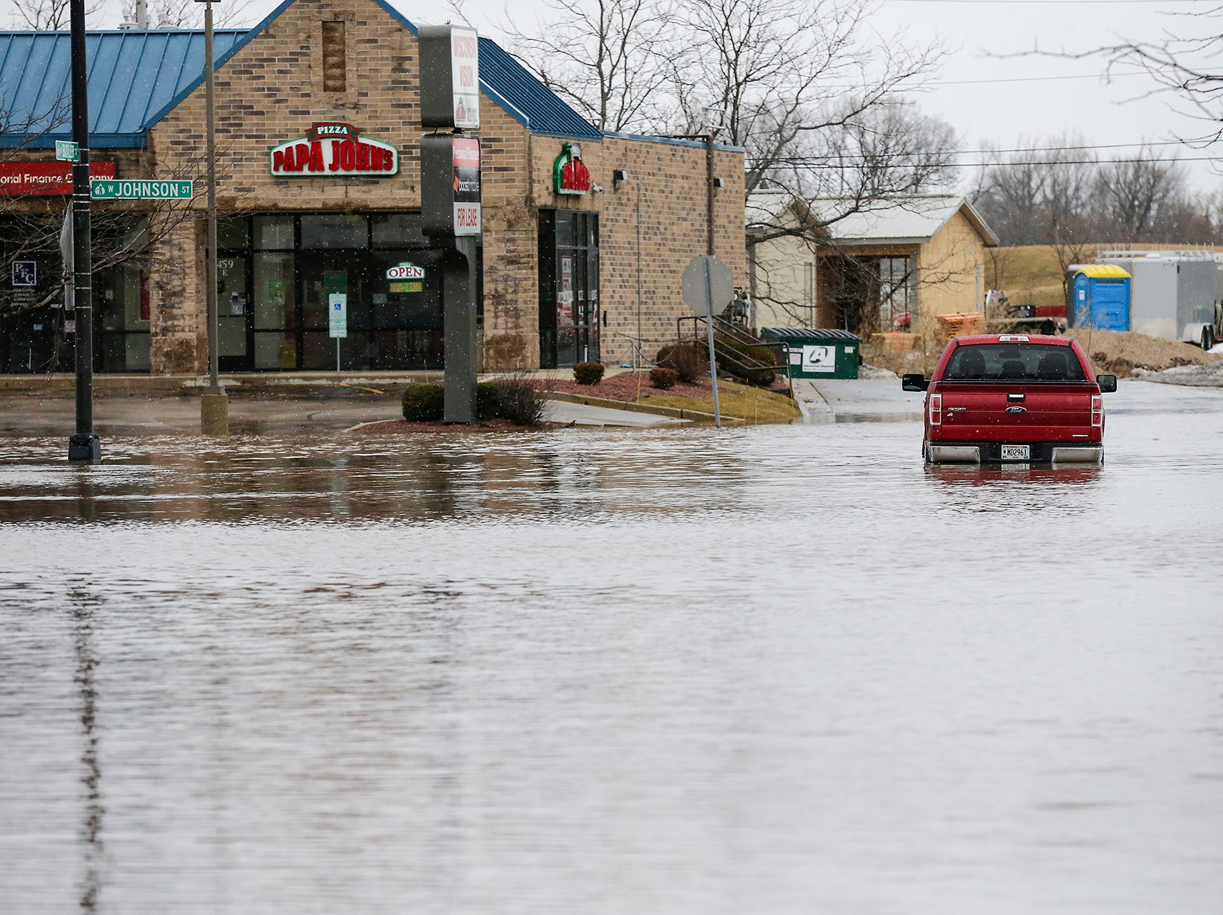 A red pick-up truck sits stalled in floodwaters Friday, March 15, 2019 at the intersection of Johnson and Burnet Streets in Fond du Lac, Wis. Ice jams on the east branch of the Fond du Lac River and heavy rain caused widespread flooding problems in the city on Thursday the 14th. Doug Raflik/USA TODAY NETWORK-Wisconsin