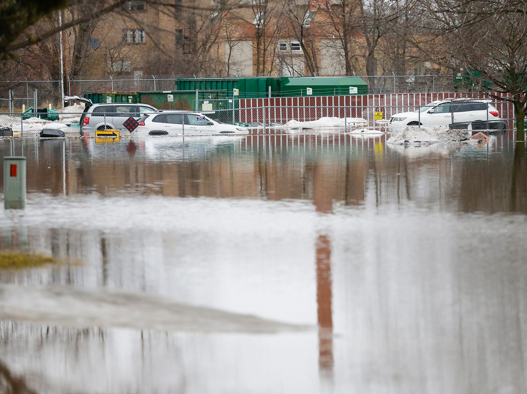 Cars ended up being partialy submerged in floodwaters Friday, March 15, 2019 in the Waste Management lot in Fond du Lac, Wis. Ice jams on the east branch of the Fond du Lac River and heavy rain caused widespread flooding problems in the city on Thursday the 14th. Doug Raflik/USA TODAY NETWORK-Wisconsin