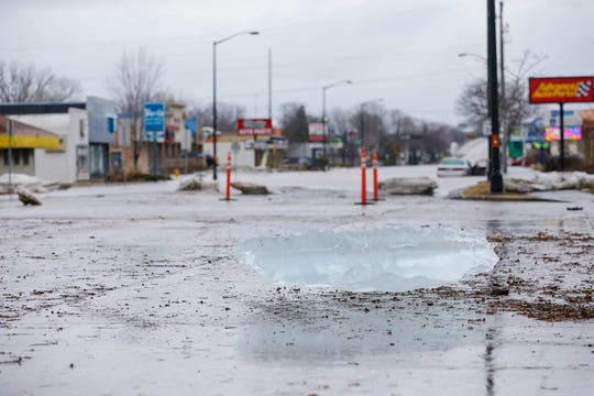 A large chunk of ice from the Fond du Lac River sits on Johnson Street Friday, March 15, 2019. Ice jams on the east branch of the Fond du Lac River and heavy rain caused widespread flooding problems in the city on Thursday the 14th. Doug Raflik/USA TODAY NETWORK-Wisconsin