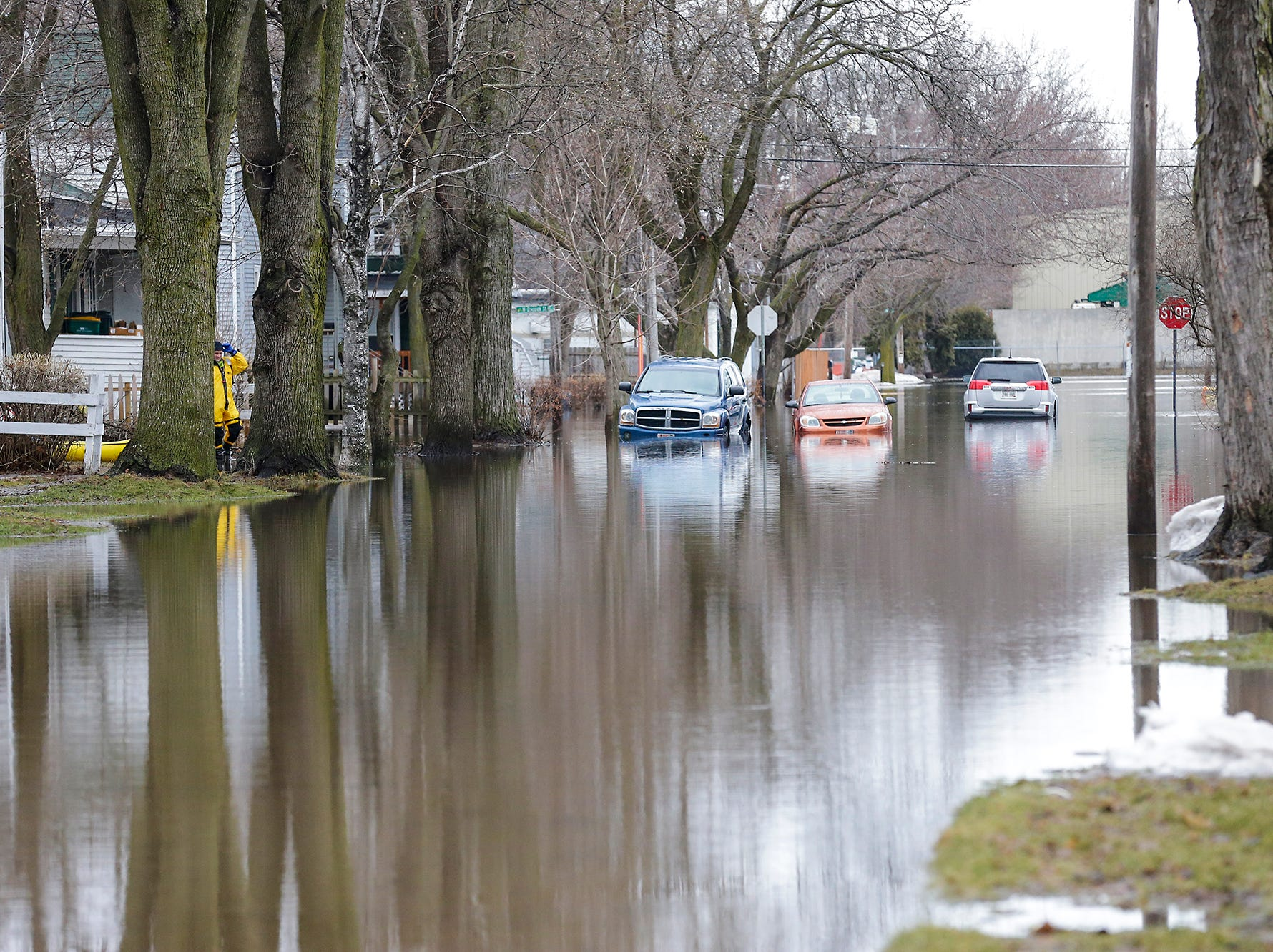 Stalled cars sit in flood waters Friday, March 15, 2019 on Gould Street between Division and Forest Streets in Fond du Lac, Wis. Ice jams on the east branch of the Fond du Lac River and heavy rain caused widespread flooding problems in the city on Thursday the 14th. Doug Raflik/USA TODAY NETWORK-Wisconsin