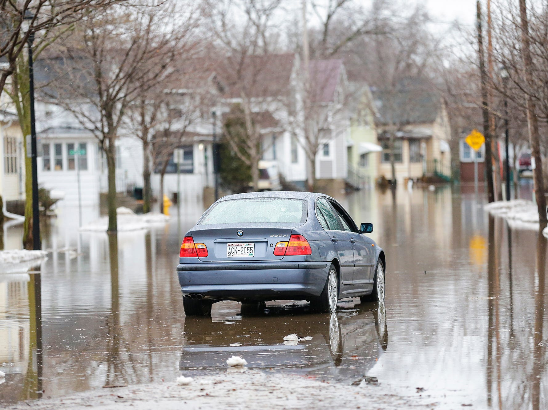 Flooding remains a problem Friday, March 15, 2019 in the 100 block of north Lincoln Street in Fond du Lac, Wis. Ice jams on the east branch of the Fond du Lac River and heavy rain caused widespread flooding problems in the city on Thursday the 14th. Doug Raflik/USA TODAY NETWORK-Wisconsin