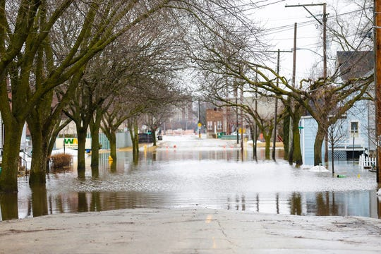 Parts of Division Street remain under water Friday. Ice jams on the east branch of the Fond du Lac River and heavy rain caused widespread flooding problems in the city Thursday.