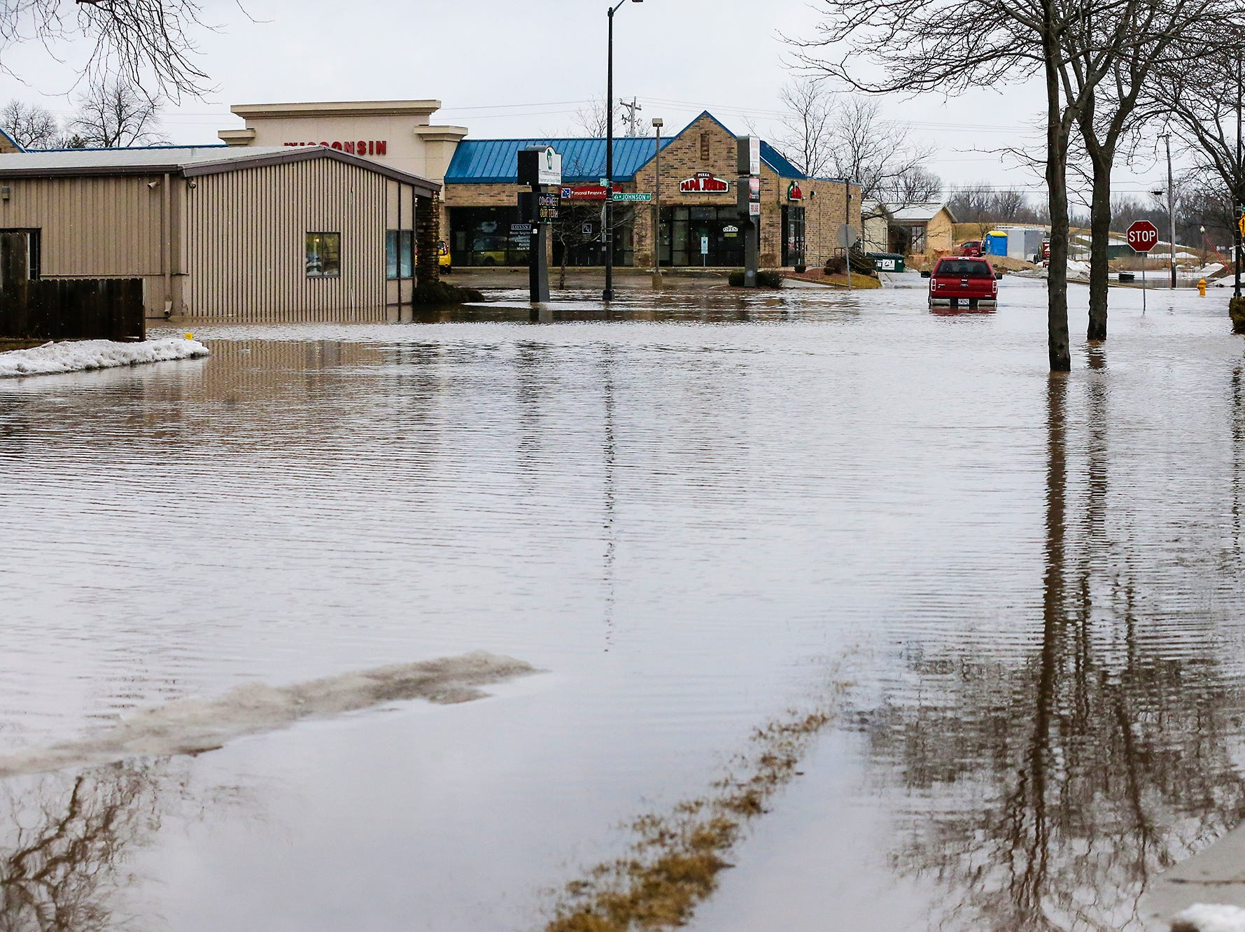 A red pick-up truck sits stalled in floodwaters Friday, March 15, 2019 at the intersection of Johnson and Butler Streets in Fond du Lac, Wis. Ice jams on the east branch of the Fond du Lac River and heavy rain caused widespread flooding problems in the city on Thursday the 14th. Doug Raflik/USA TODAY NETWORK-Wisconsin