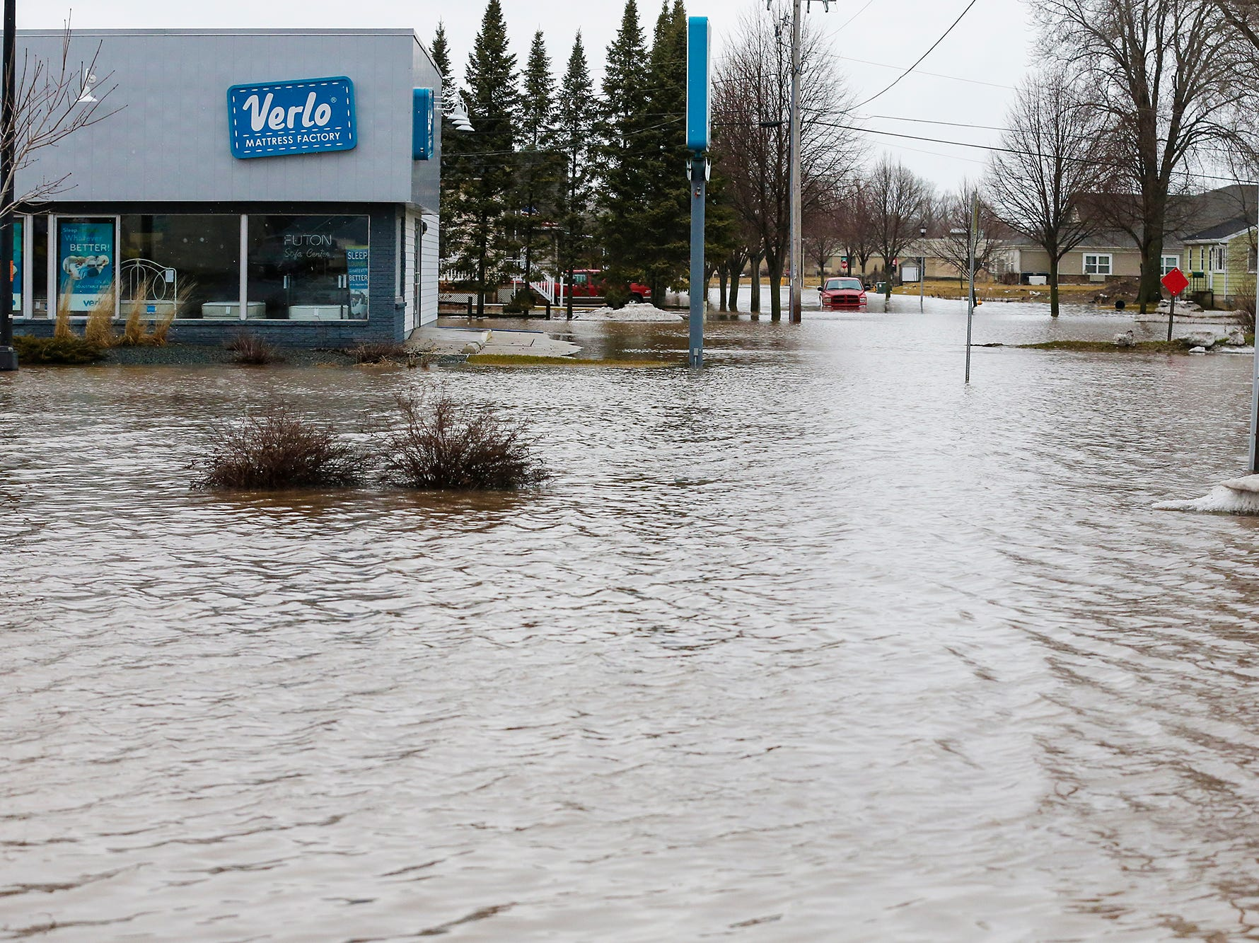 Flood waters remain Friday, March 15, 2019 on Johnson Street west of Hickory Street in Fond du Lac, Wis. Ice jams on the east branch of the Fond du Lac River and heavy rain caused widespread flooding problems in the city on Thursday the 14th. Doug Raflik/USA TODAY NETWORK-Wisconsin