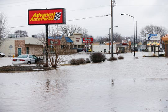 A car sits stalled in floodwaters Friday, March 15, 2019 on Johnson Street east of Seymour Street in Fond du Lac, Wis. Ice jams on the east branch of the Fond du Lac River and heavy rain caused widespread flooding problems in the city on Thursday the 14th. Doug Raflik/USA TODAY NETWORK-Wisconsin