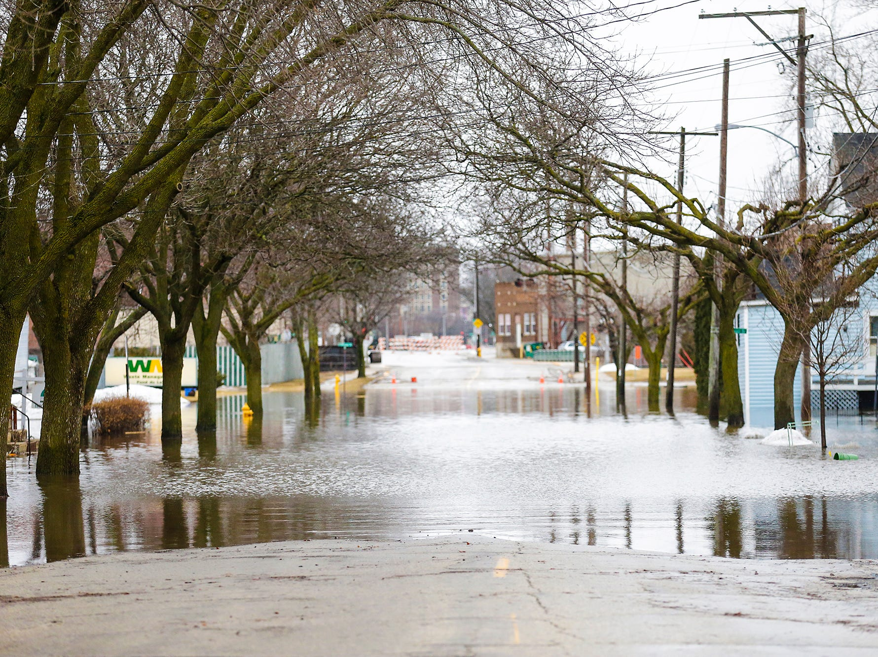 Parts of Division Street remain under water Friday, March 15, 2019. Ice jams on the east branch of the Fond du Lac River and heavy rain caused widespread flooding problems in the city on Thursday the 14th. Doug Raflik/USA TODAY NETWORK-Wisconsin