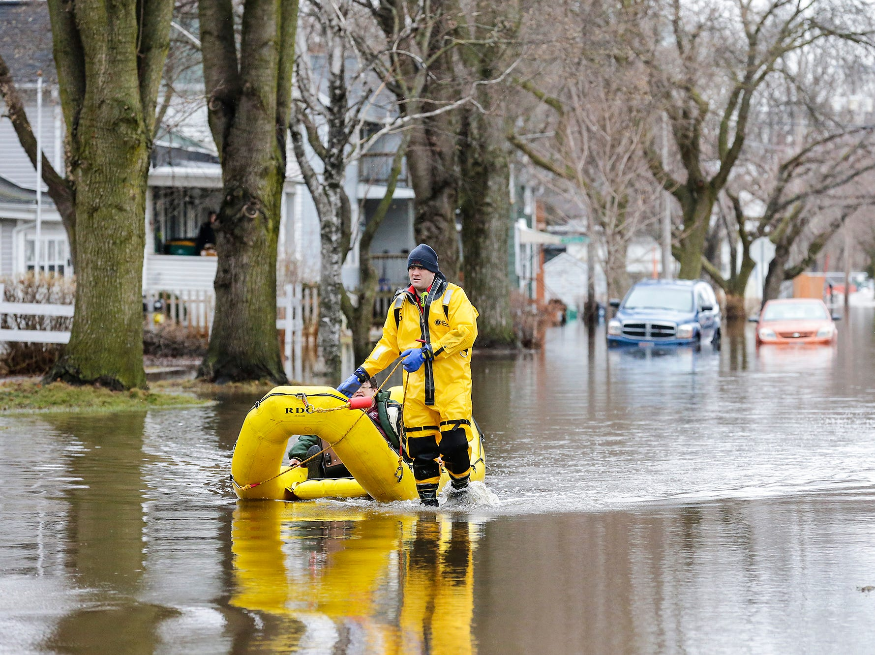 A Fond du Lac Fire/Rescue member brings a woman to safety after evacuating her Friday, March 15, 2019 from her house on Gould Street in Fond du Lac, Wis. Ice jams on the east branch of the Fond du Lac River and heavy rain caused widespread flooding problems in the city on Thursday the 14th. Doug Raflik/USA TODAY NETWORK-Wisconsin