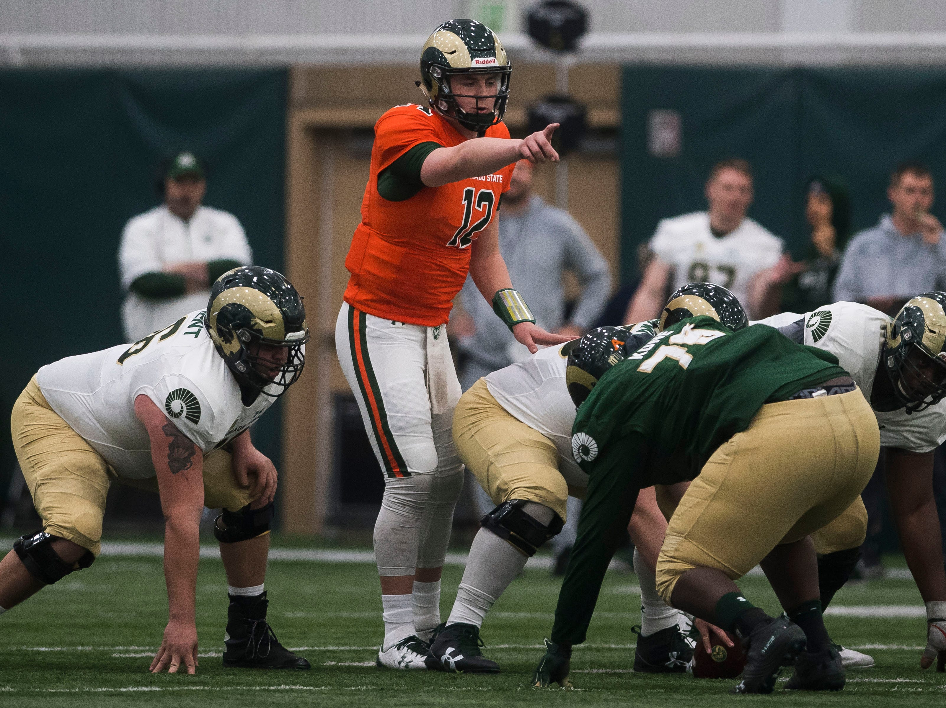 CSU junior quarterback Patrick O'Brien (12) signals to his team during CSU's Spring game on Thursday, March 14, 2019, at their indoor practice facility in Fort Collins, Colo.