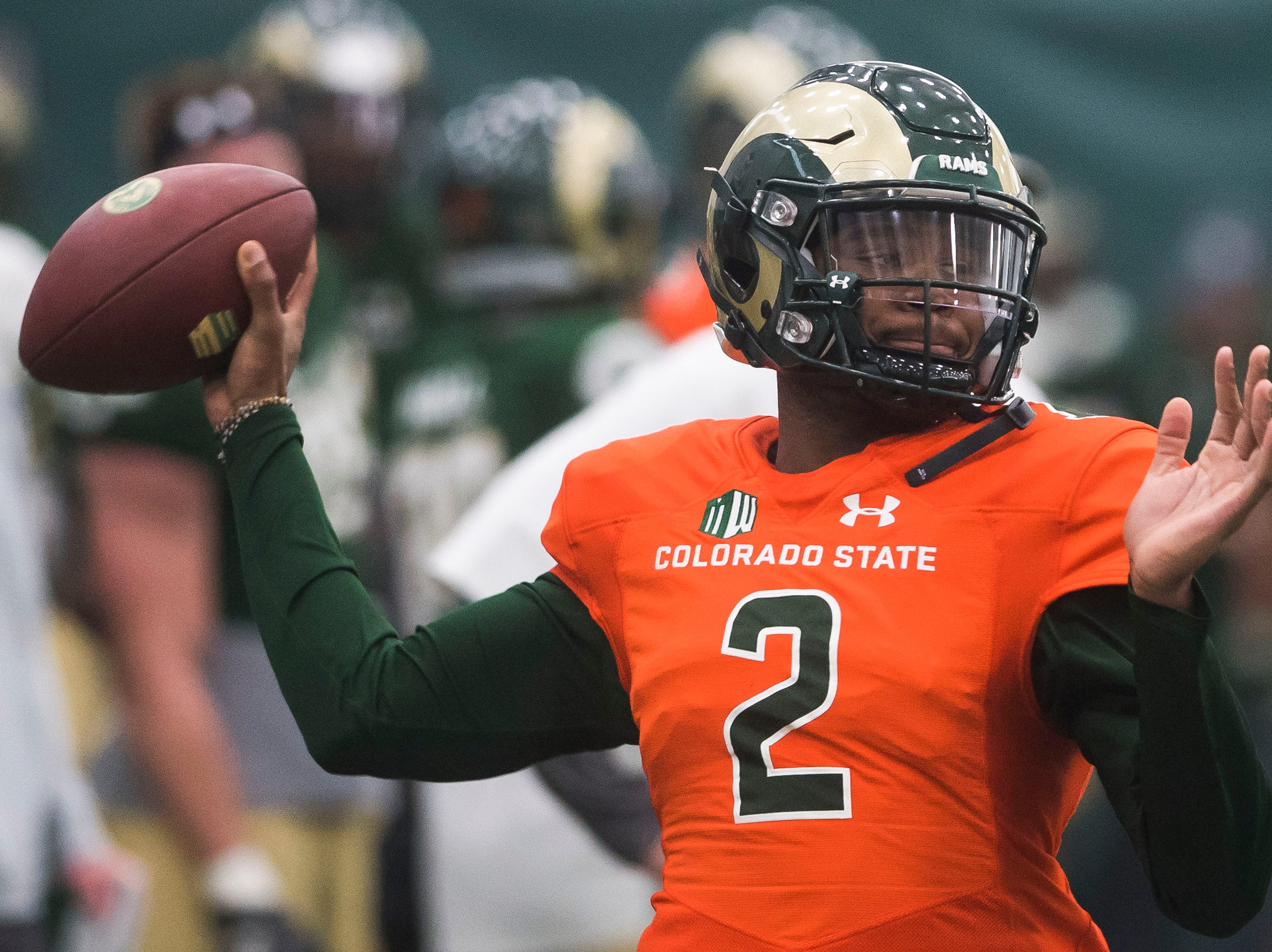 CSU sophomore quarterback Justice McCoy (2) throws during drills preceding CSU's Spring game on Thursday, March 14, 2019, at their indoor practice facility in Fort Collins, Colo.
