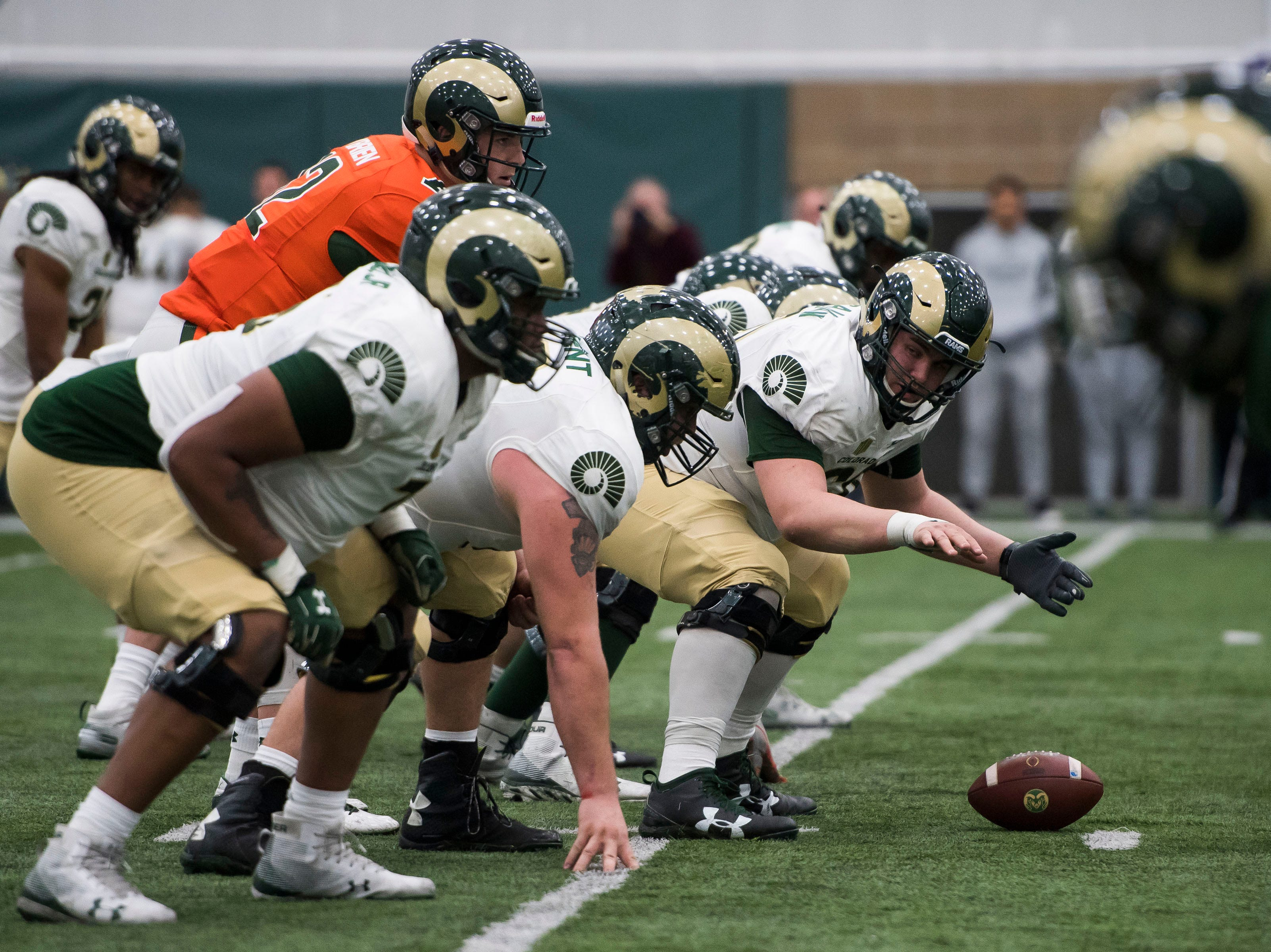 CSU freshman center Florian McCann (60) signals to the offensive line during CSU's Spring game on Thursday, March 14, 2019, at their indoor practice facility in Fort Collins, Colo.