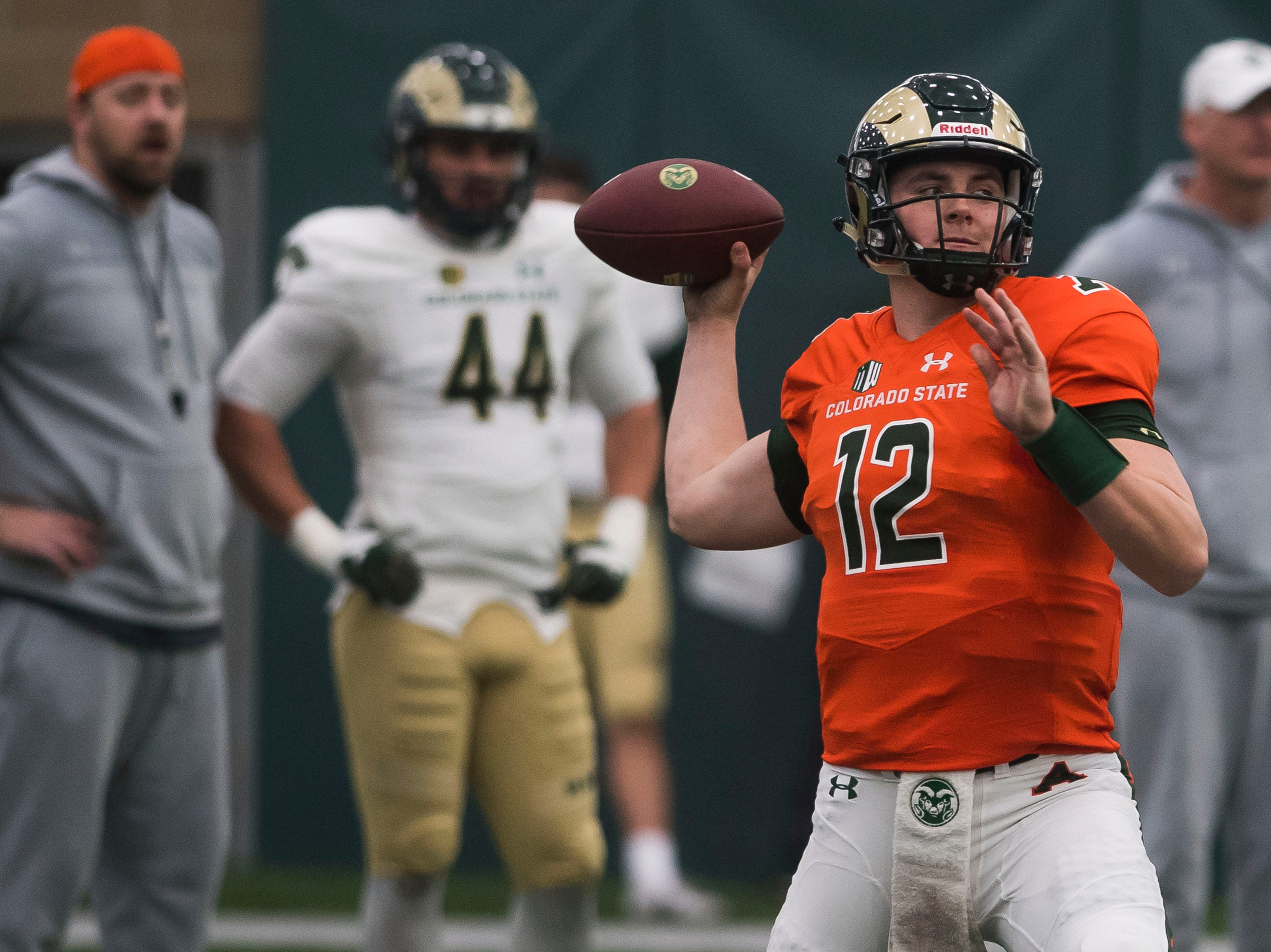 CSU junior quarterback Patrick O'Brien (12) throws during drills preceding CSU's Spring game on Thursday, March 14, 2019, at their indoor practice facility in Fort Collins, Colo.