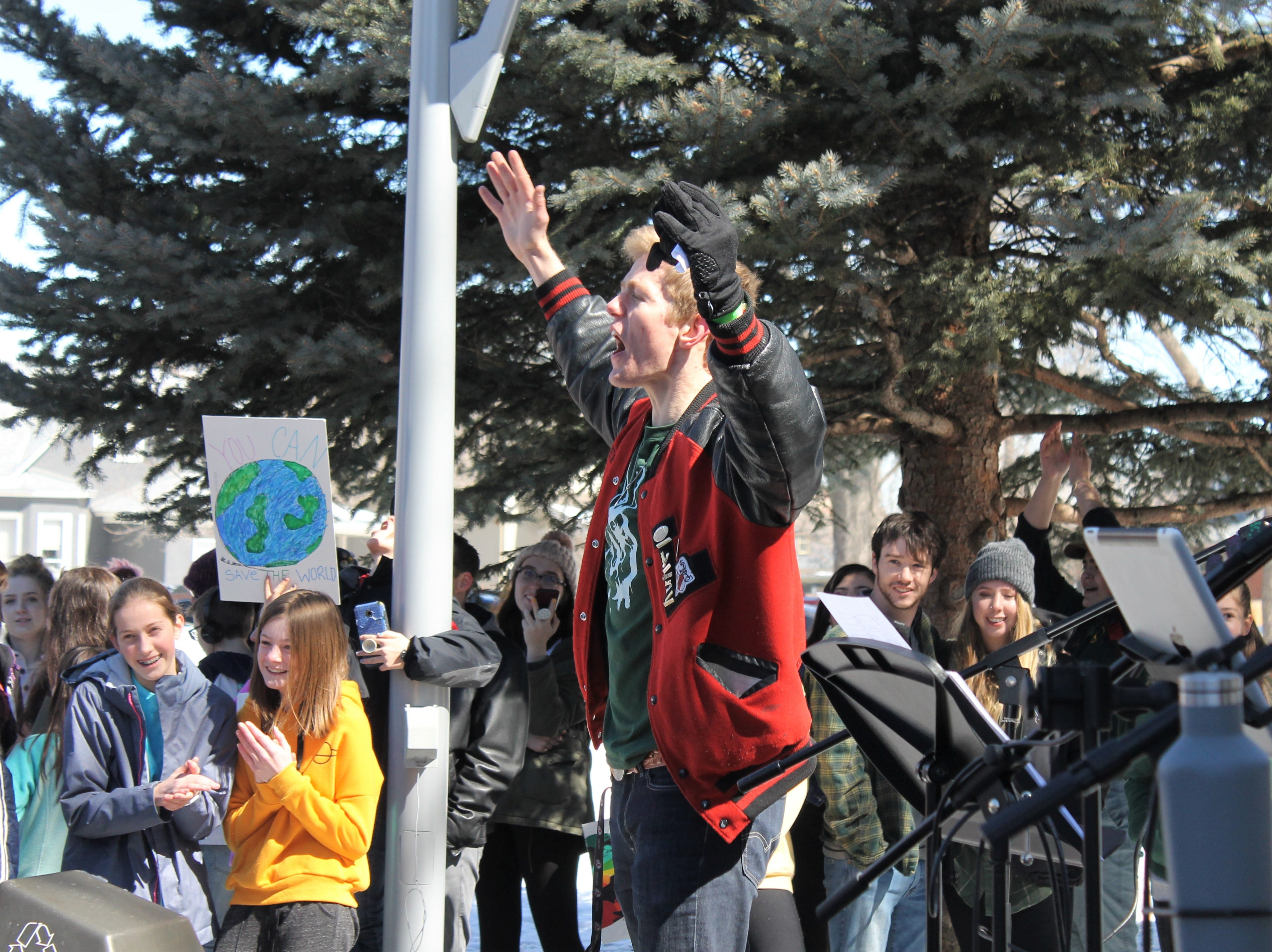 Ehret Nottingham leads a chant at the Northern Colorado Climate Strike March 15, 2019. Hundreds of students from Thompson School District and Poudre School District ditched class to call for better climate policy.