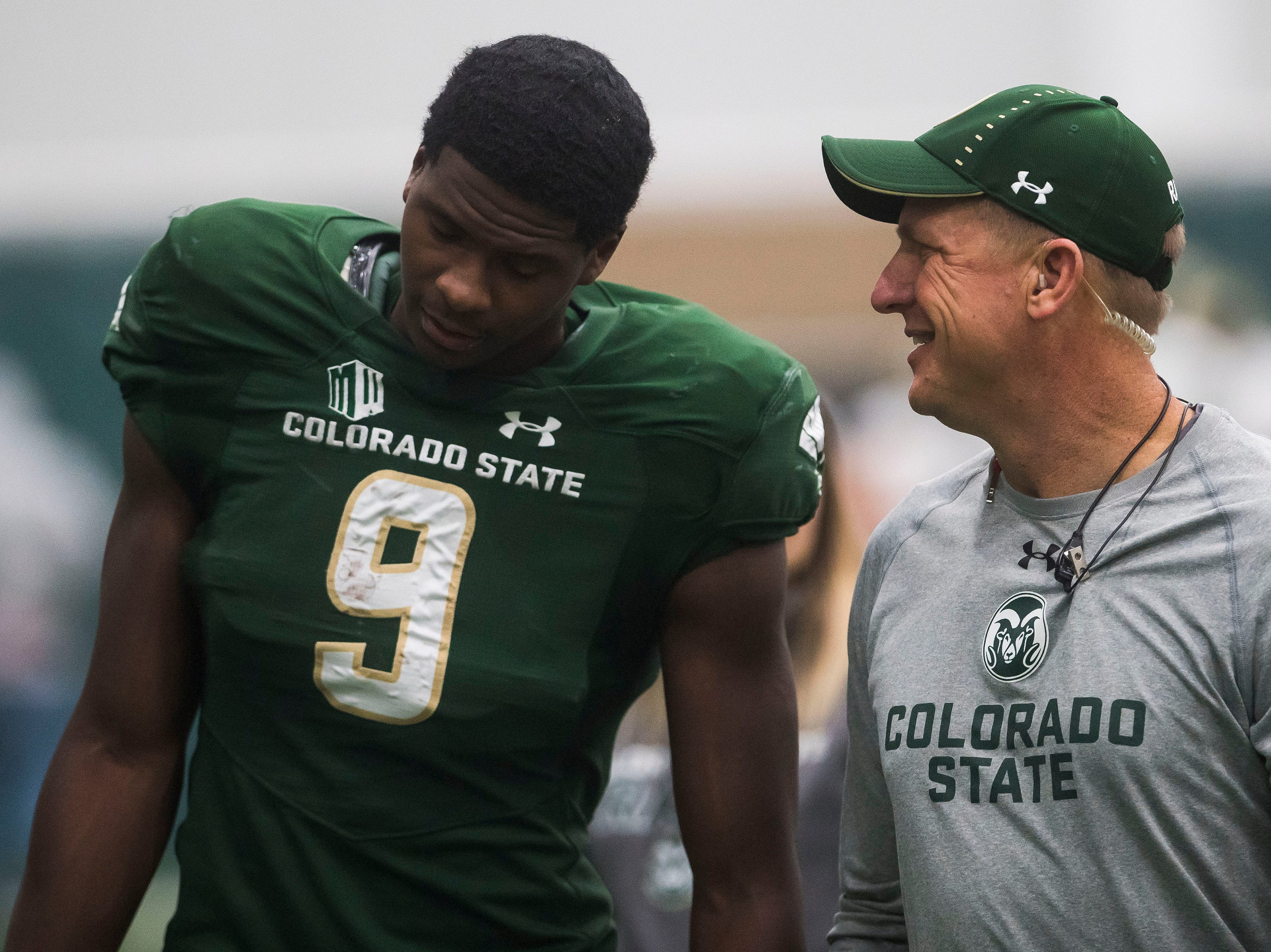 CSU junior receiver Warren Jackson (9) talks to a coach during CSU's Spring game on Thursday, March 14, 2019, at their indoor practice facility in Fort Collins, Colo.