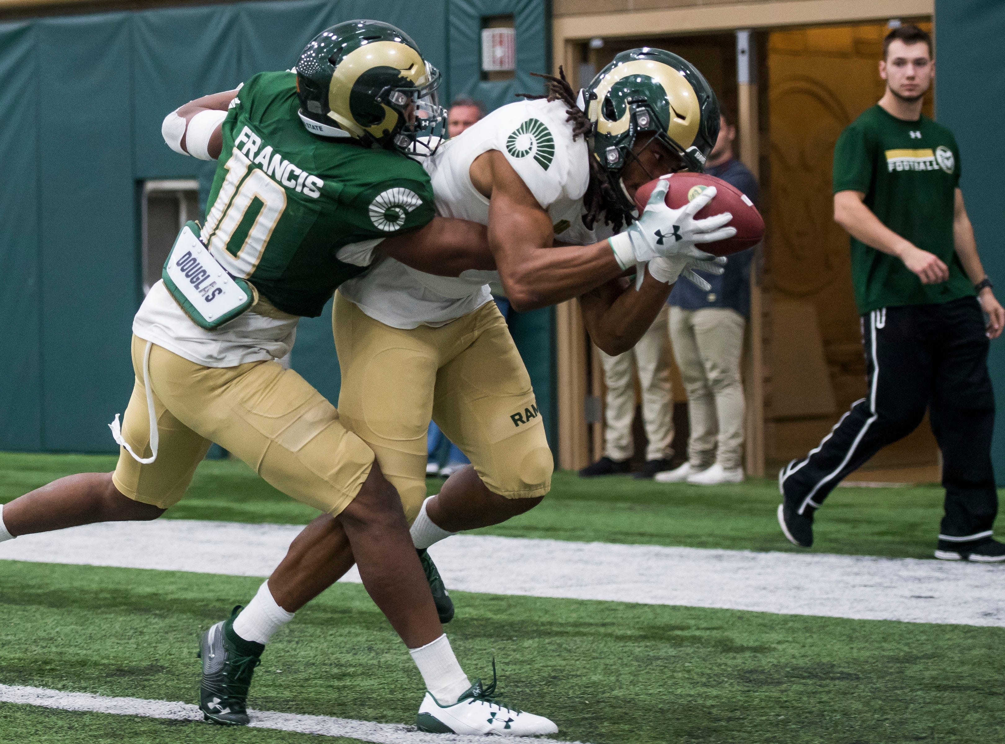 CSU sophomore wide receiver A'Jon Vivens (20) secures a touchdown reception while being defended by sophomore safety Tywan Francis (10) during CSU's Spring game on Thursday, March 14, 2019, at their indoor practice facility in Fort Collins, Colo.