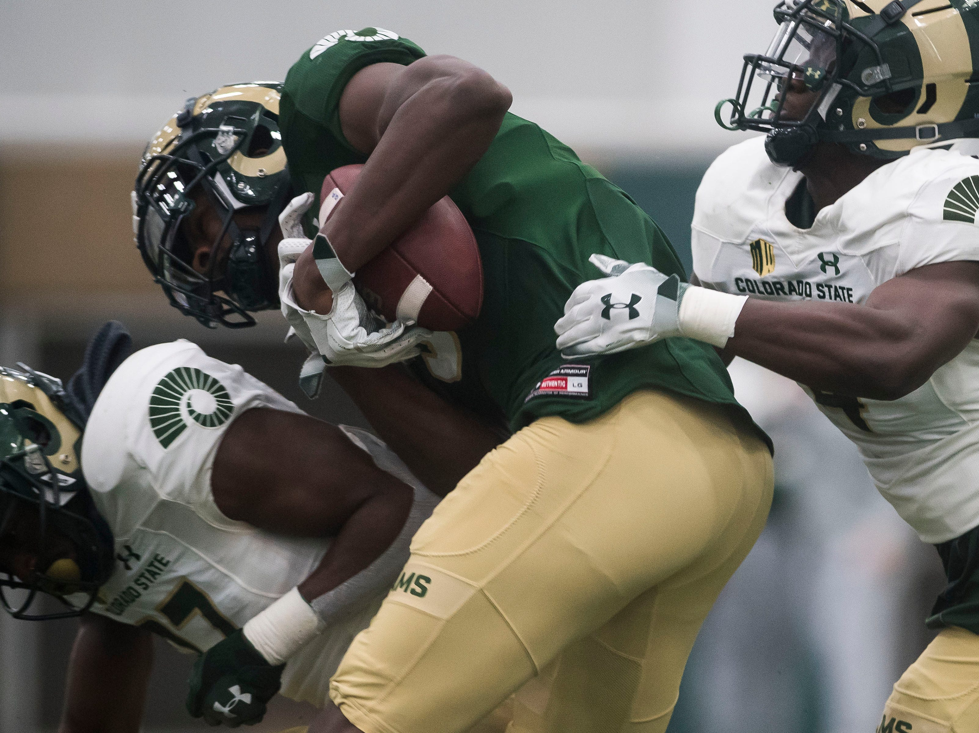 CSU junior wide receiver Warren Jackson (9) pulls in a touchdown reception while being defended by sophomore cornerback Rashad Ajayi (4) and junior linebacker Logan Stewart (37) during CSU's Spring game on Thursday, March 14, 2019, at their indoor practice facility in Fort Collins, Colo.