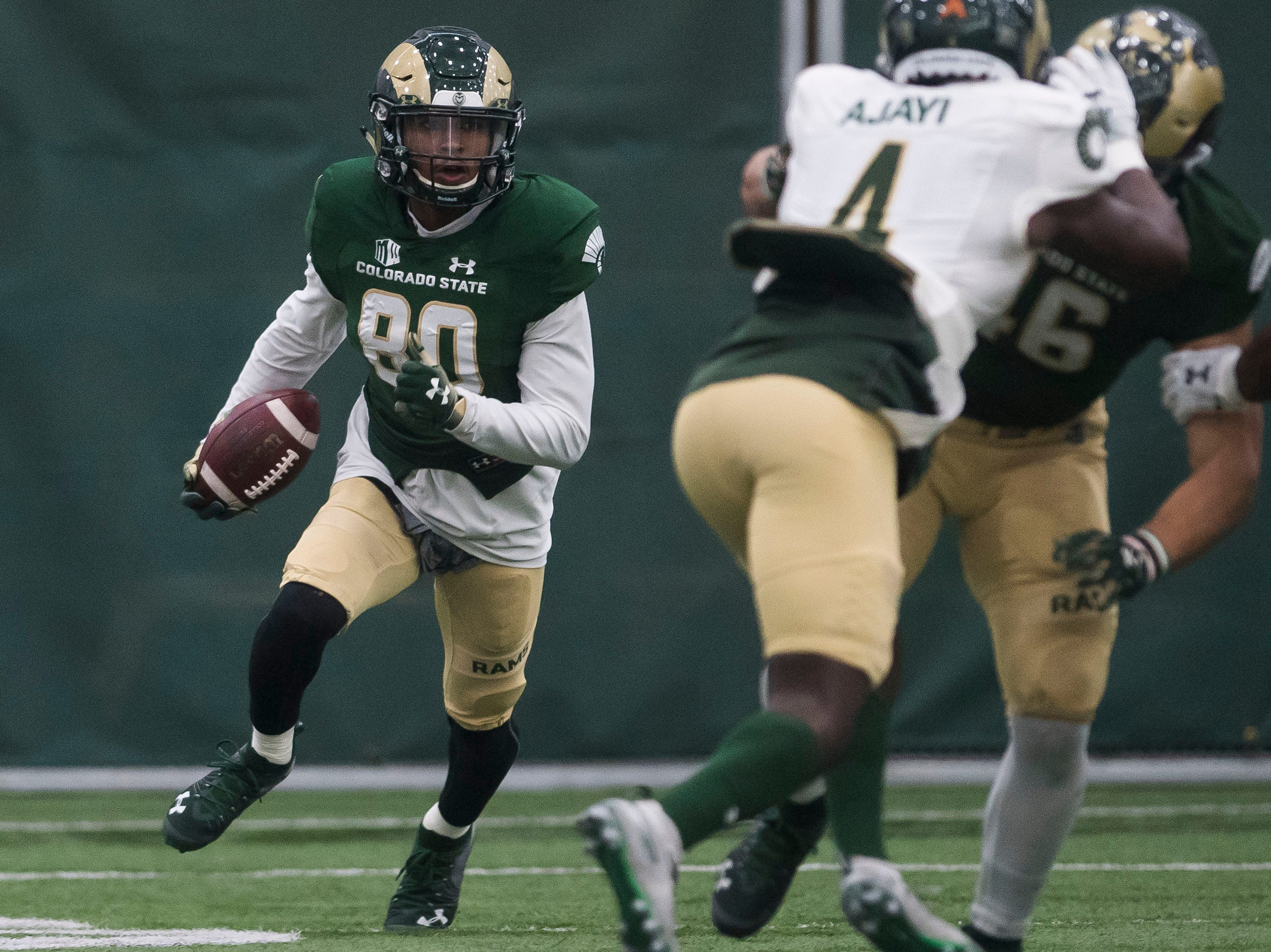 CSU sophomore receiver Nikko Hall (80) turns upfield after a reception during CSU's Spring game on Thursday, March 14, 2019, at their indoor practice facility in Fort Collins, Colo.
