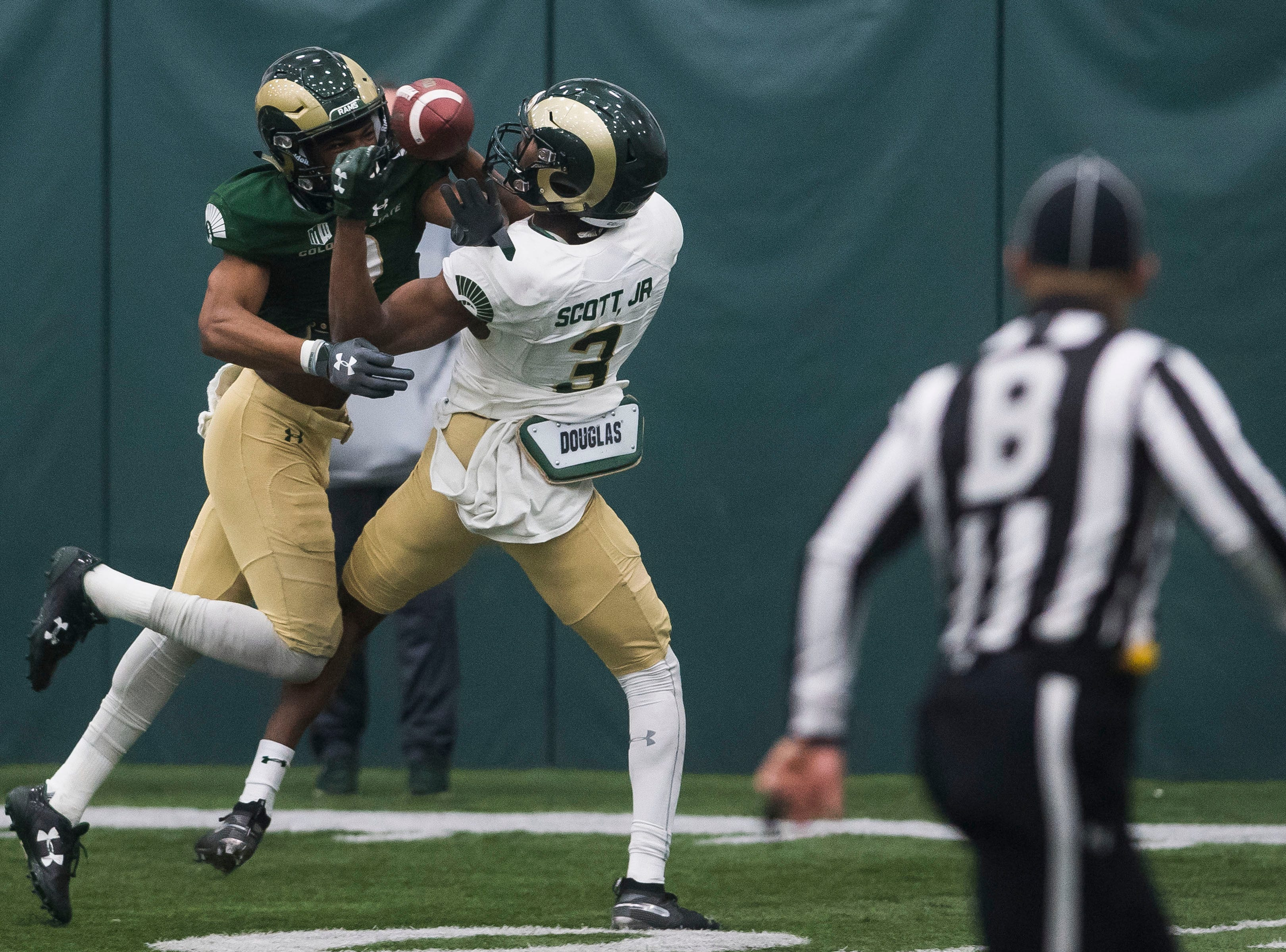 CSU junior corner Dajon Owens (2) defends a pass intended for sophomore receiver E.J. Scott (3) during CSU's Spring game on Thursday, March 14, 2019, at their indoor practice facility in Fort Collins, Colo.