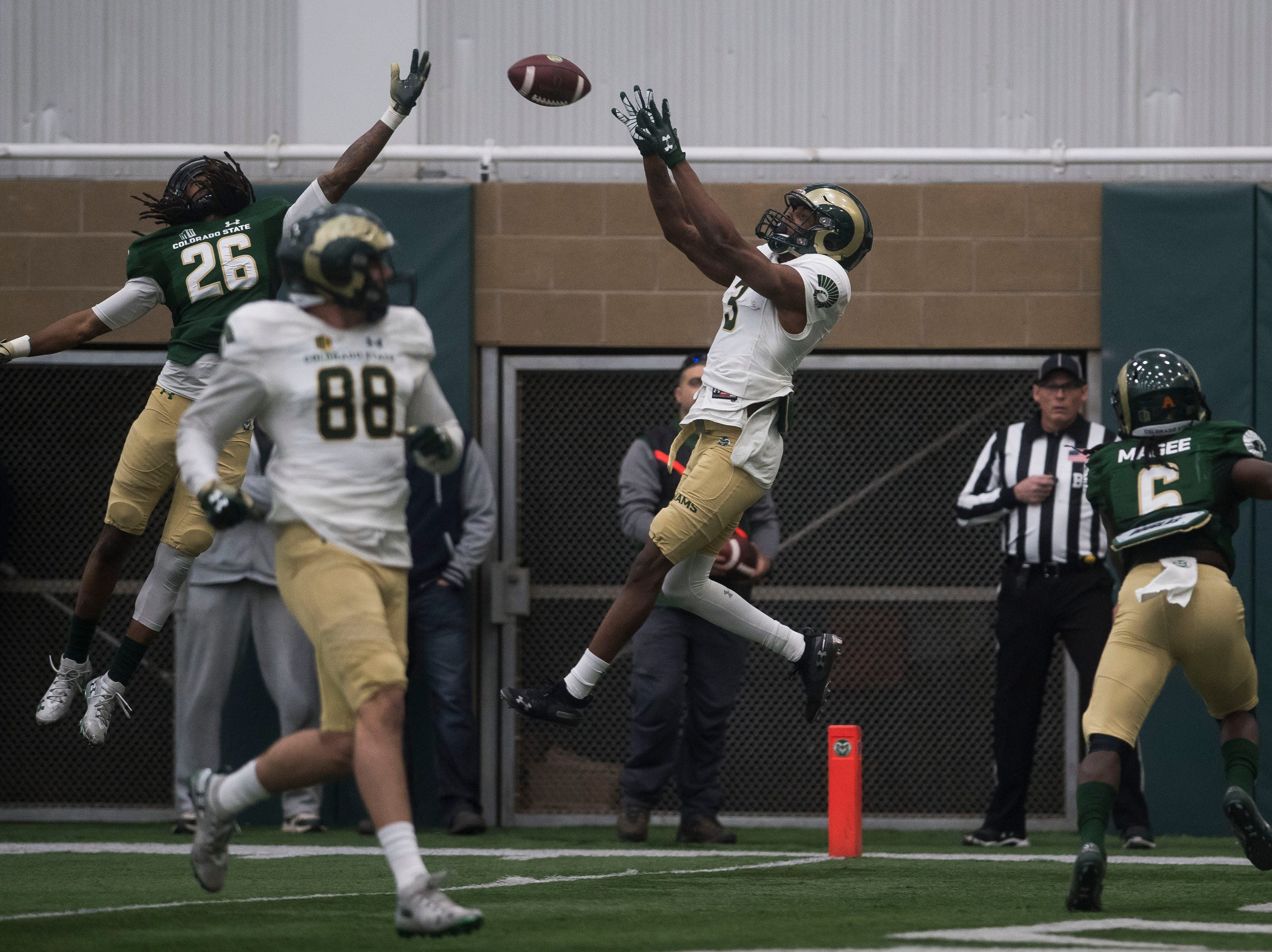 CSU sophomore wide receiver E.J. Scott (3) pulls in a touchdown reception while being defended by junior corner Mean McNeal (26) during CSU's Spring game on Thursday, March 14, 2019, at their indoor practice facility in Fort Collins, Colo.