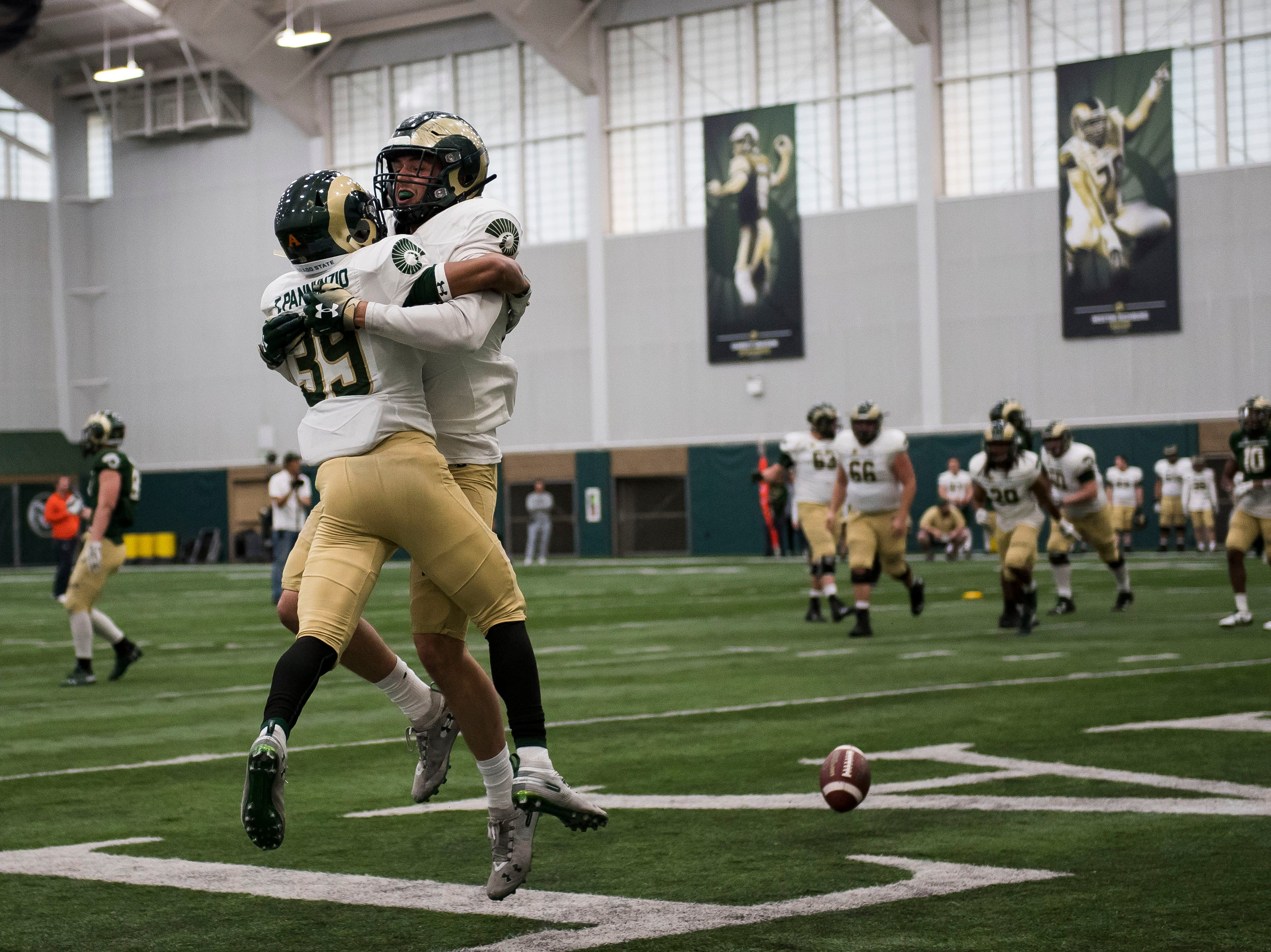 CSU sophomore receiver Thomas Pannunzio (39) celebrates a touchdown reception by sophomore tight end Griffin Hammer (88) during CSU's Spring game on Thursday, March 14, 2019, at their indoor practice facility in Fort Collins, Colo.